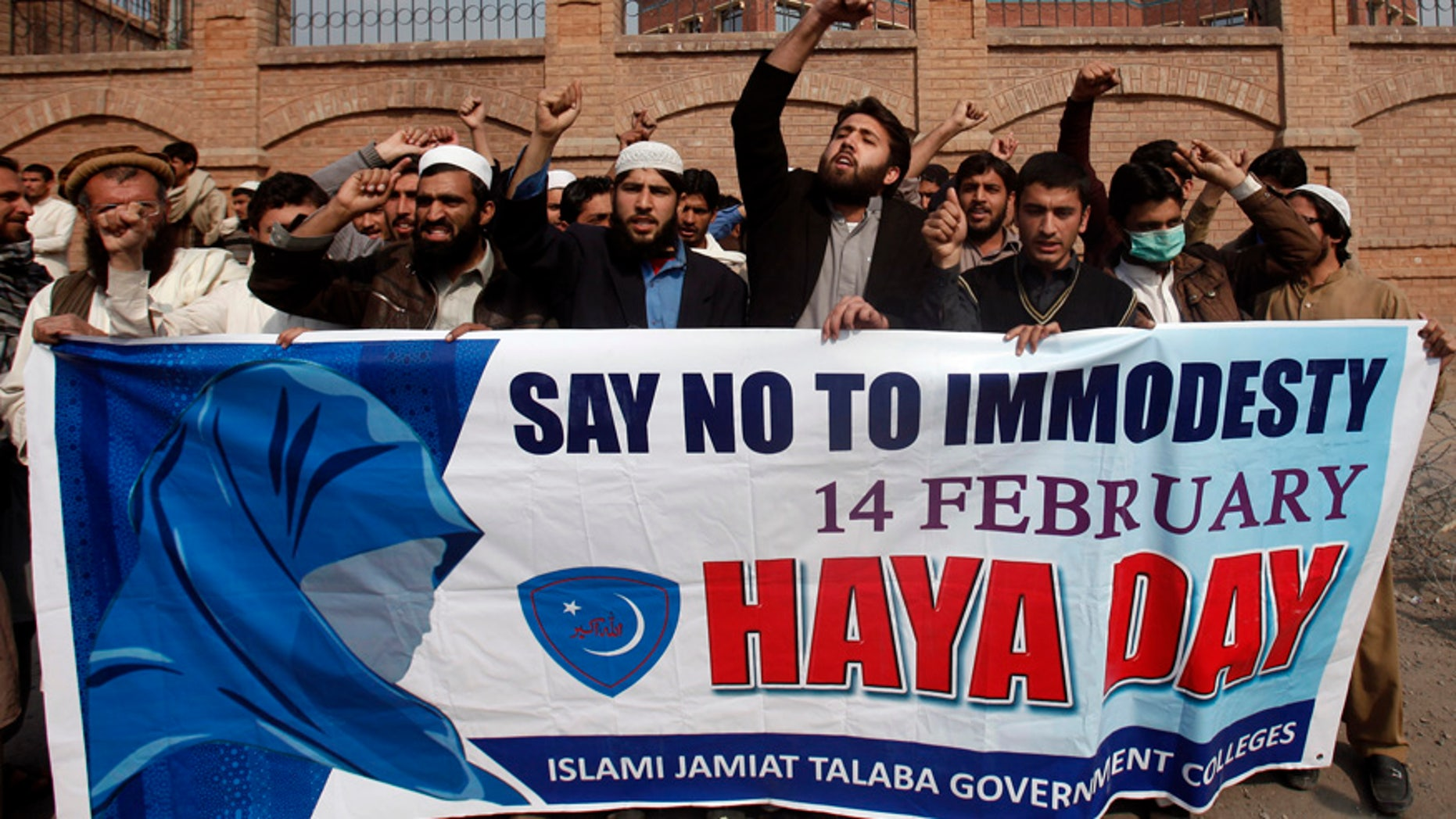Feb. 14, 2014: Supporters of Islami Jamiat Talaba, a student wing of Pakistan's religious and political party Jamaat-e-Islami, shout slogans to condemn Valentine's Day during a protest at the University of Peshawar.