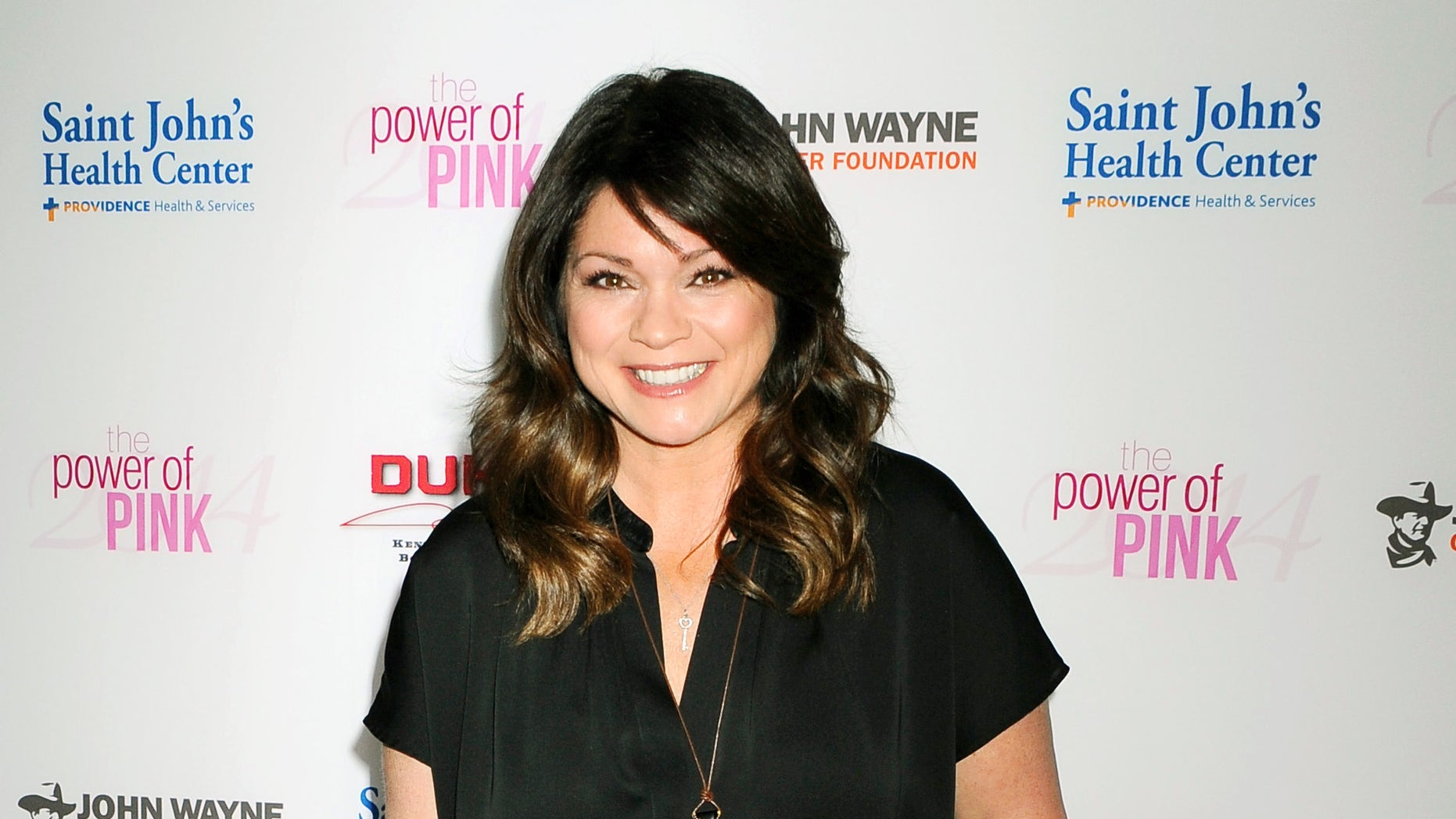 In this Oct. 23, 2014 file photo, Valerie Bertinelli arrives at 2014 Power of Pink: An Acoustic Evening With Pink And Friends in Los Angeles. (AP)