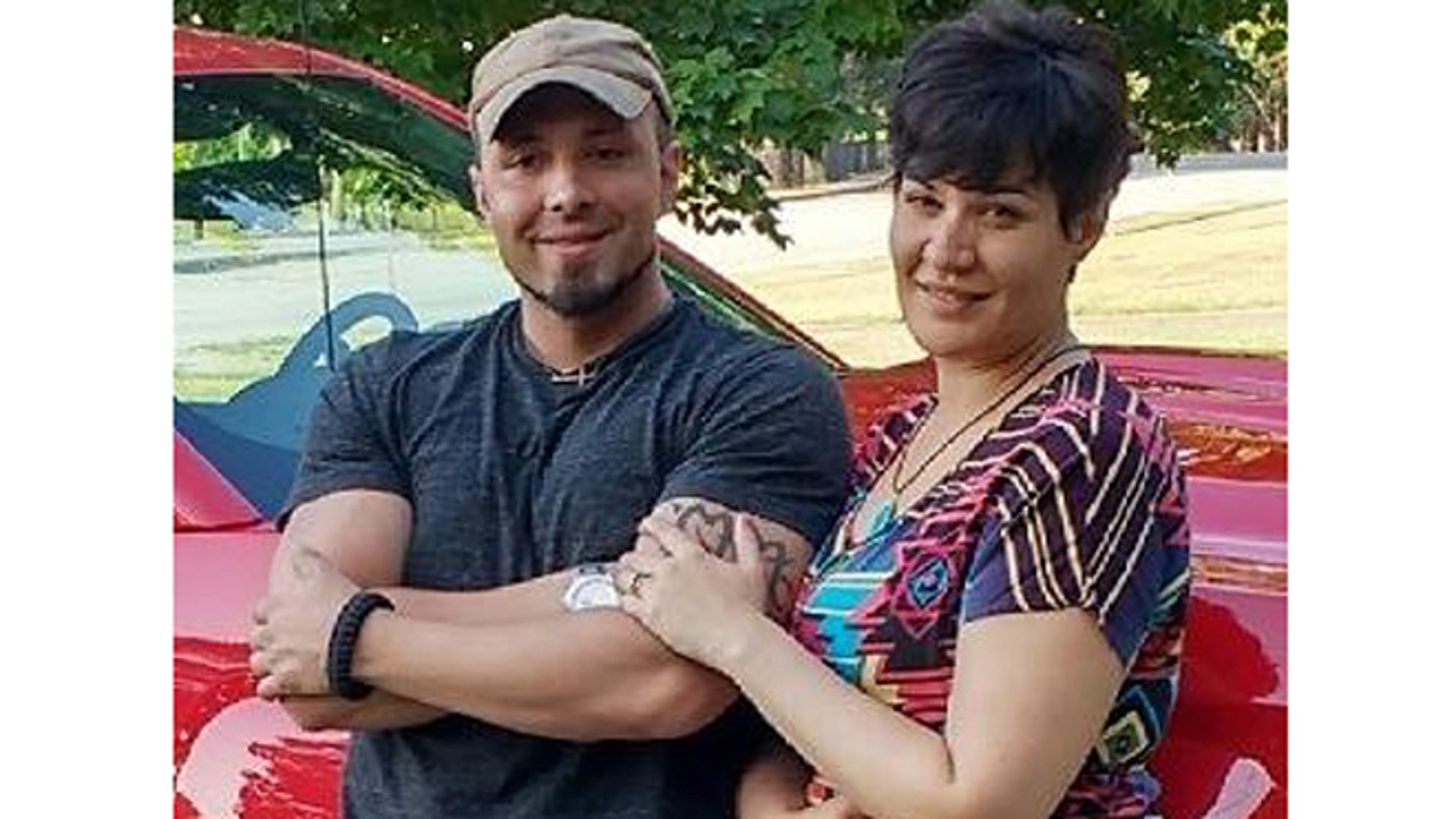 Valerie Tieman, right, is seen with her husband in photo taken in July. (Maine State Police)