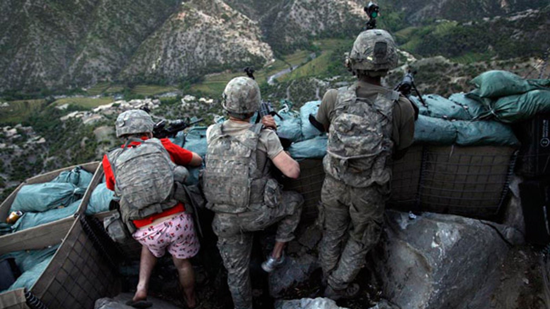 May 11 2009: U.S. soldiers responded to Taliban fire outside their bunker in Korengal Valley, Afghanistan.