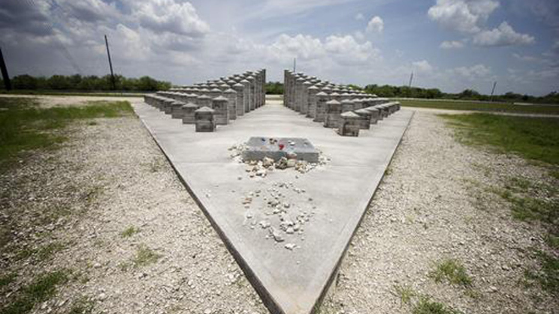 HOLD FOR STORY BY JENNIFER KAY- In this June 25, 2014 file photo, the ValuJet Memorial is seen in the Florida Everglades in  Everglades National Park. ValuJet Flight 592 crashed while trying to make an emergency return to Miami on May 11,1996, killing all 110 people on board. Relatives of the victims of Flight 592 will meet in the Florida Everglades to mark the 20th anniversary. (AP Photo/J. Pat Carter, File)