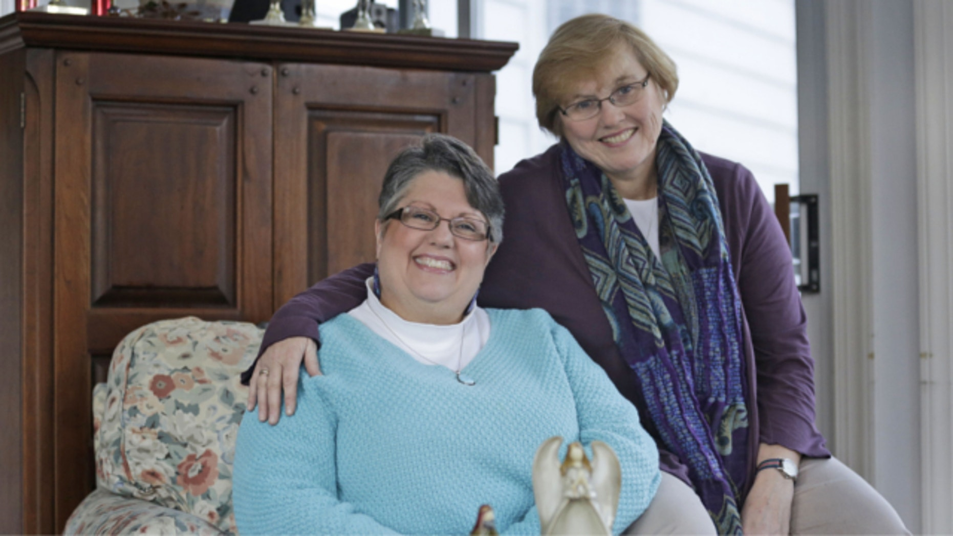 FILE: Nov. 25, 2013: Carol Schall, left, and her partner, Mary Townley, are shown at their home in Richmond, Va. The couple, who were married in California in 2008, decided to join a lawsuit challenging Virginia's ban on same-sex marriage.