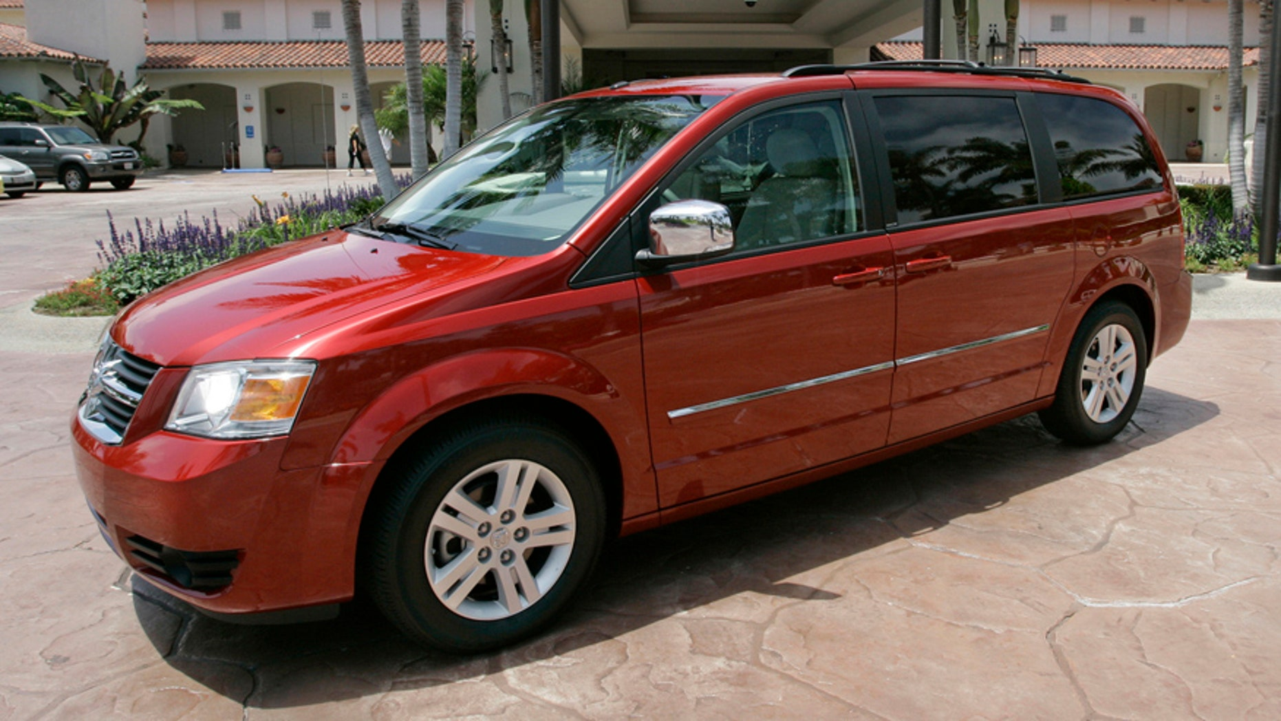 FILE - This July 17, 2007 file photo shows the 2008 Dodge Grand Caravan at the Four Seasons Hotel in Carlsbad, Calif. On Wednesday, June 18, 2014, the National Highway Traffic Safety Administration posted documents on its website detailing an investigation of about 700,000 Dodge Journey SUVs and Chrysler Town and Country and Dodge Grand Caravan minivans from the 2008 to 2010 model years. The agency wants to see if the keys can fall out of the run position under harsh roadway conditions. (AP Photo/Lenny Ignelzi, File)