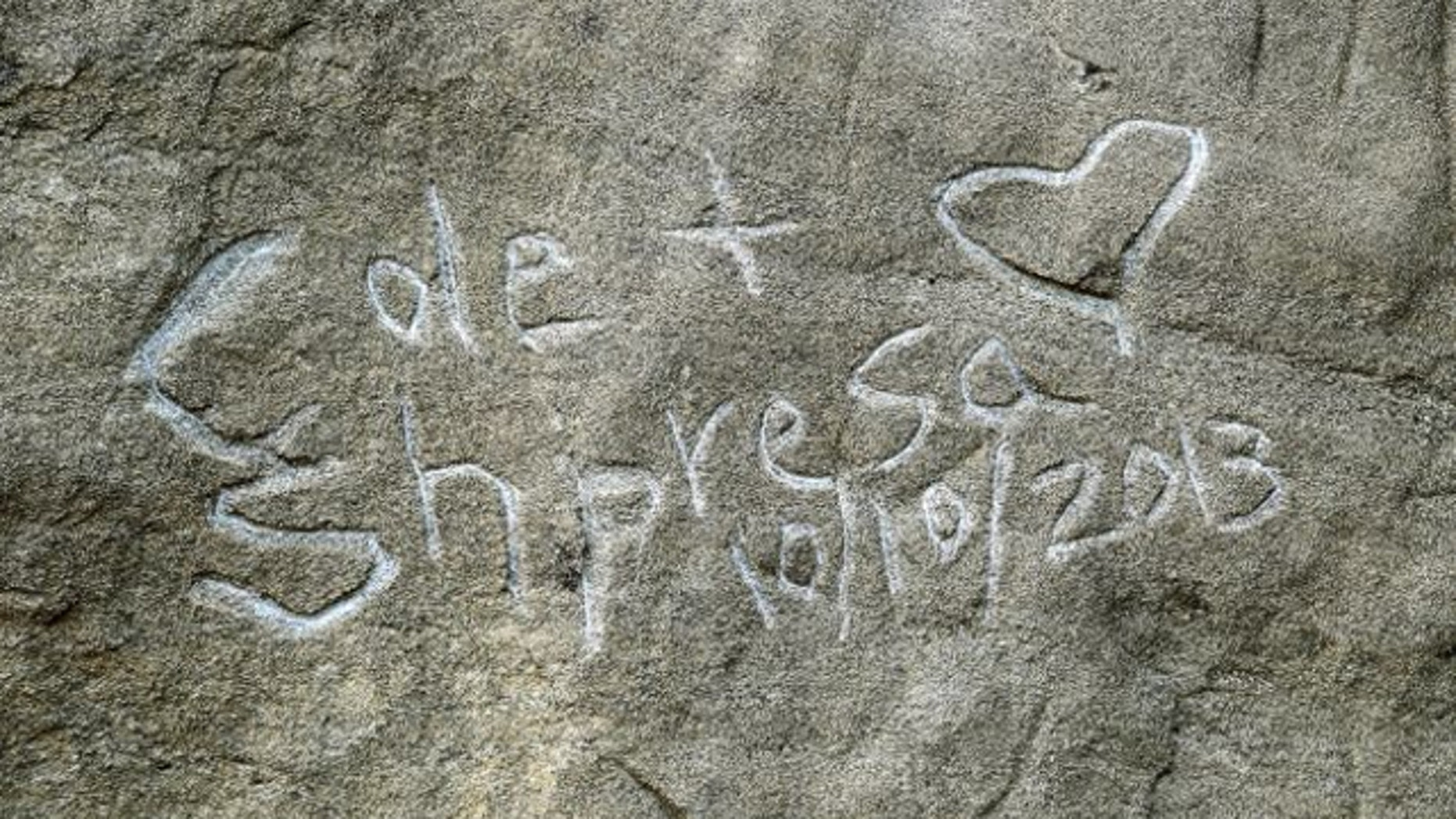 """Oct.. 31, 2013: Graffito spelling """"Cole & Shpresa 10/10/2013"""" is seen carved into the Pompeys Pillar National Monument in Montana."""