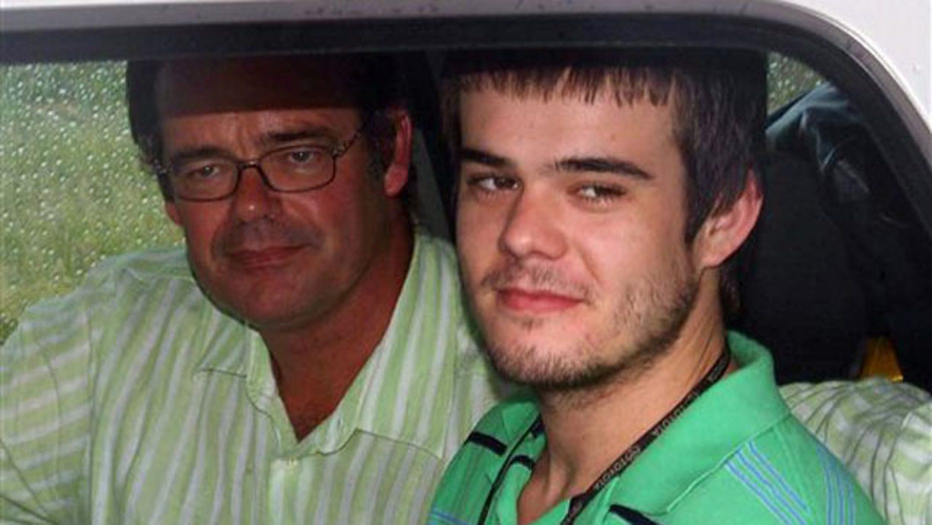 December 7, 2007  Joran van der Sloot, right, sits with his father, Paulus Van Der Sloot, after Joran after being released from custody near Oranjestad, Aruba. (AP)