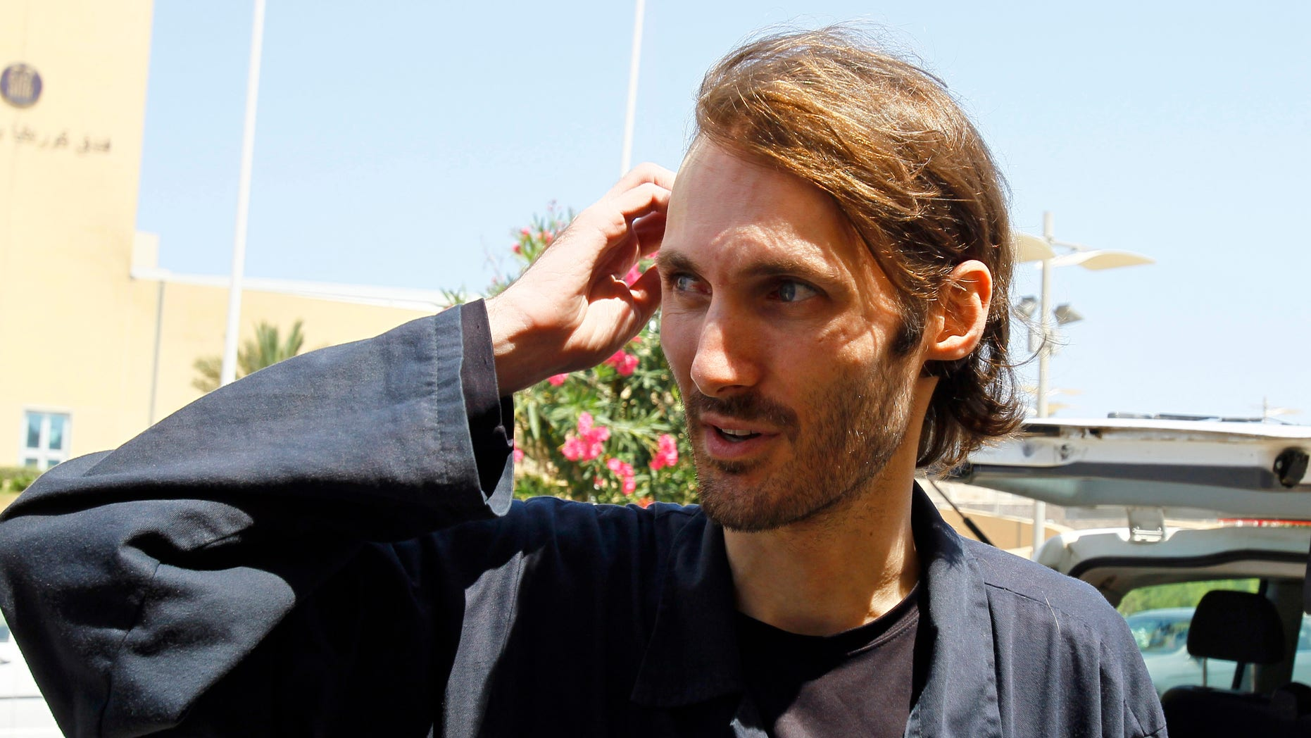 American writer and filmmaker Matthew VanDyke , from Baltimore, released from Abu Salim prison after spending 6 months imprisoned, is seen in front of the Corinthia Hotel in Tripoli, Libya, Saturday, Aug. 27, 2011.
