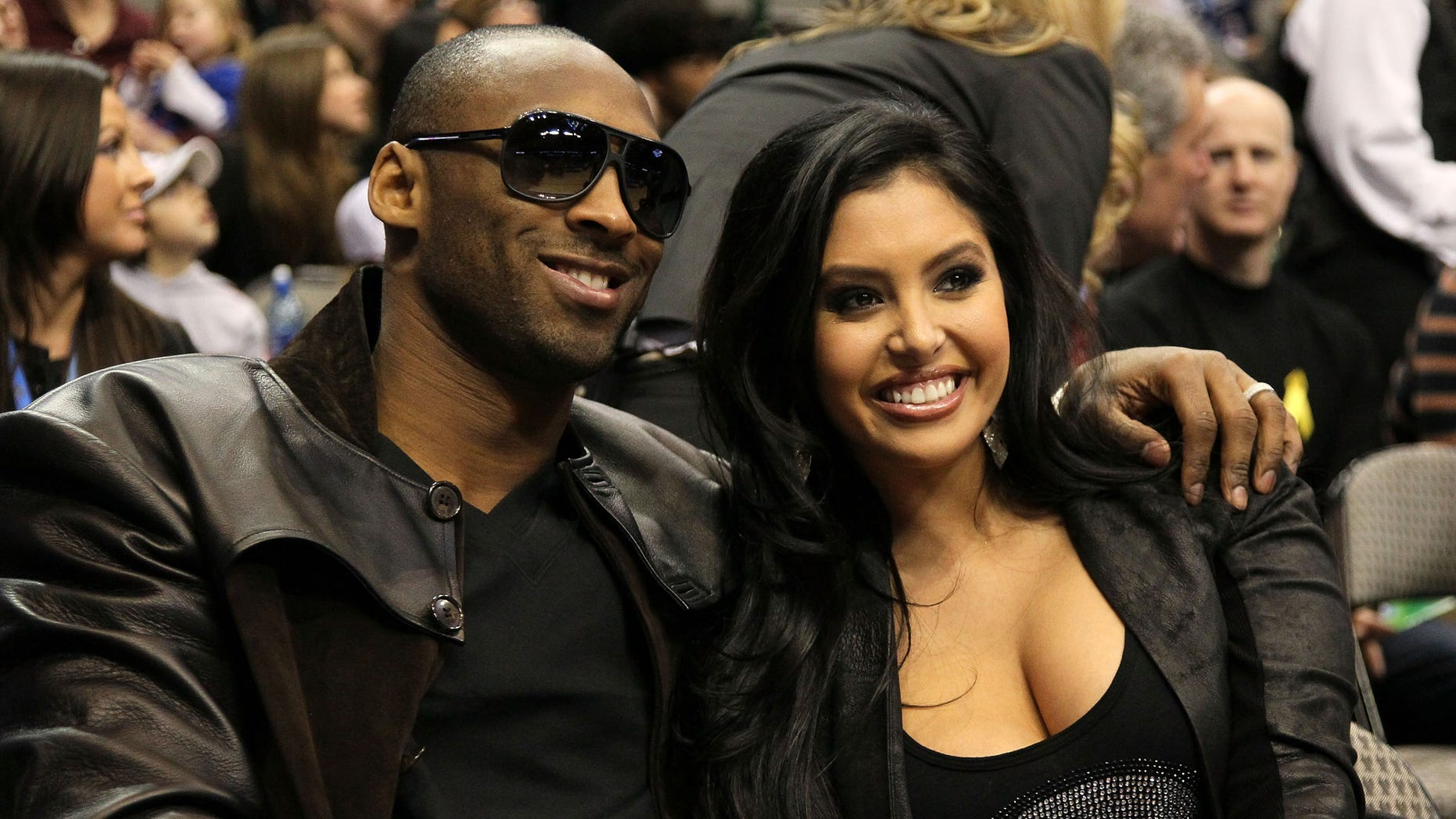 DALLAS - FEBRUARY 13:  Kobe Bryant #24 of the Los Angeles Lakers smiles with his wife Vanessa Lynne during the Taco Bell Skills Challenge on All-Star Saturday Night, part of 2010 NBA All-Star Weekend at American Airlines Center on February 13, 2010 in Dallas, Texas. NOTE TO USER: User expressly acknowledges and agrees that, by downloading and or using this photograph, User is consenting to the terms and conditions of the Getty Images License Agreement.  (Photo by Jed Jacobsohn/Getty Images)
