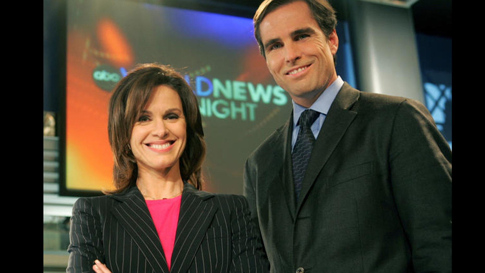 """Elizabeth Vargas and Bob Woodruff pose in the studio for ABC's """"World News Tonight,"""" Monday, Dec. 5, 2005, in New York after the network's news division announced the pair would co-anchor the news show beginning Jan. 3, 2006."""