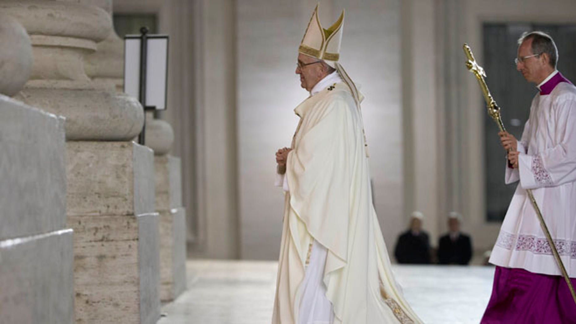Pope Francis leaves after he greeted nuns and priests, in St. Peter's Square, at the Vatican, Tuesday, Feb. 2, 2016. The Pope earlier celebrated a mass inside the Basilica and then walked out to greet groups on nuns and priests. (AP Photo/Andrew Medichini)