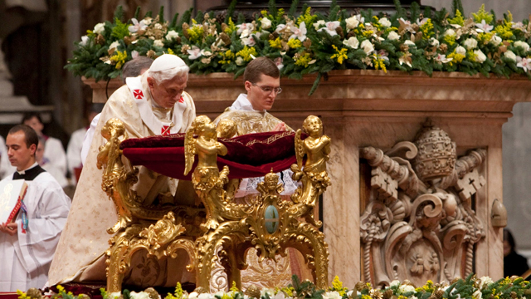 Dec. 24, 2011: Pope Benedict XVI kneels in prayer as he celebrates Christmas Mass in St. Peter's Basilica at the Vatican.
