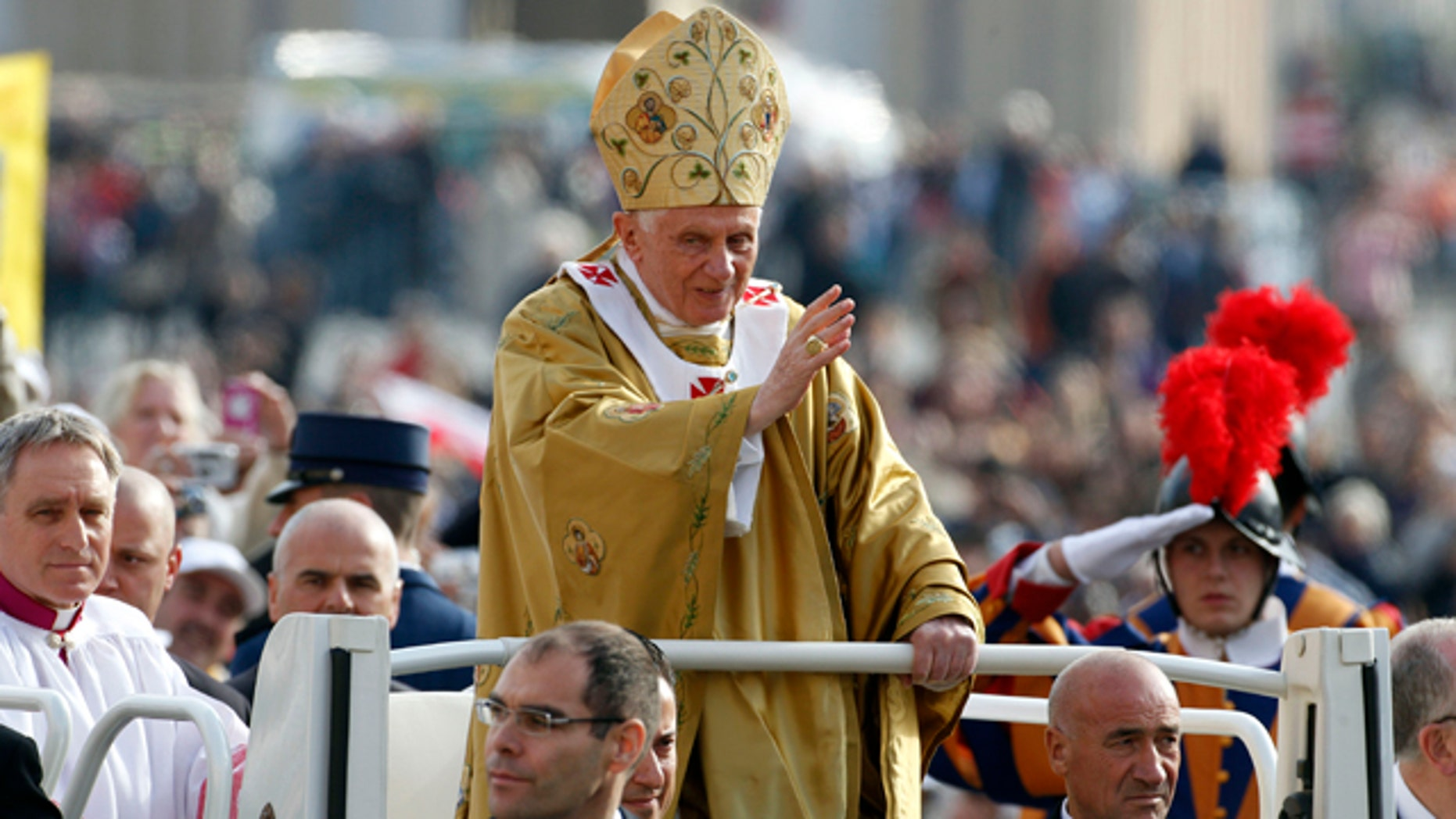 Oct. 23, 2011: Pope Benedict XVI, center, delivers his blessing as he arrives in St. Peter's square at the Vatican to celebrate a beatification mass.