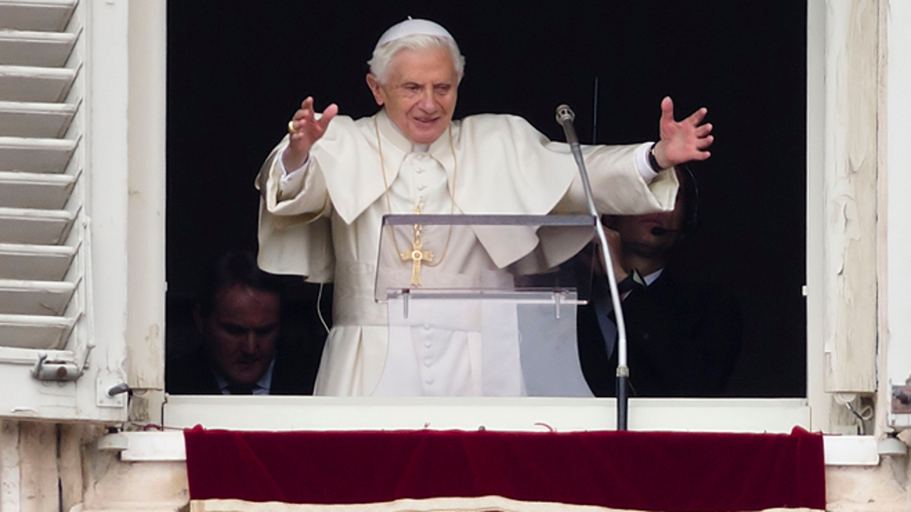 Feb. 24, 2013: Pope Benedict XVI delivers his blessing during his last Angelus noon prayer, from the window of his studio overlooking St. Peter's Square, at the Vatican.