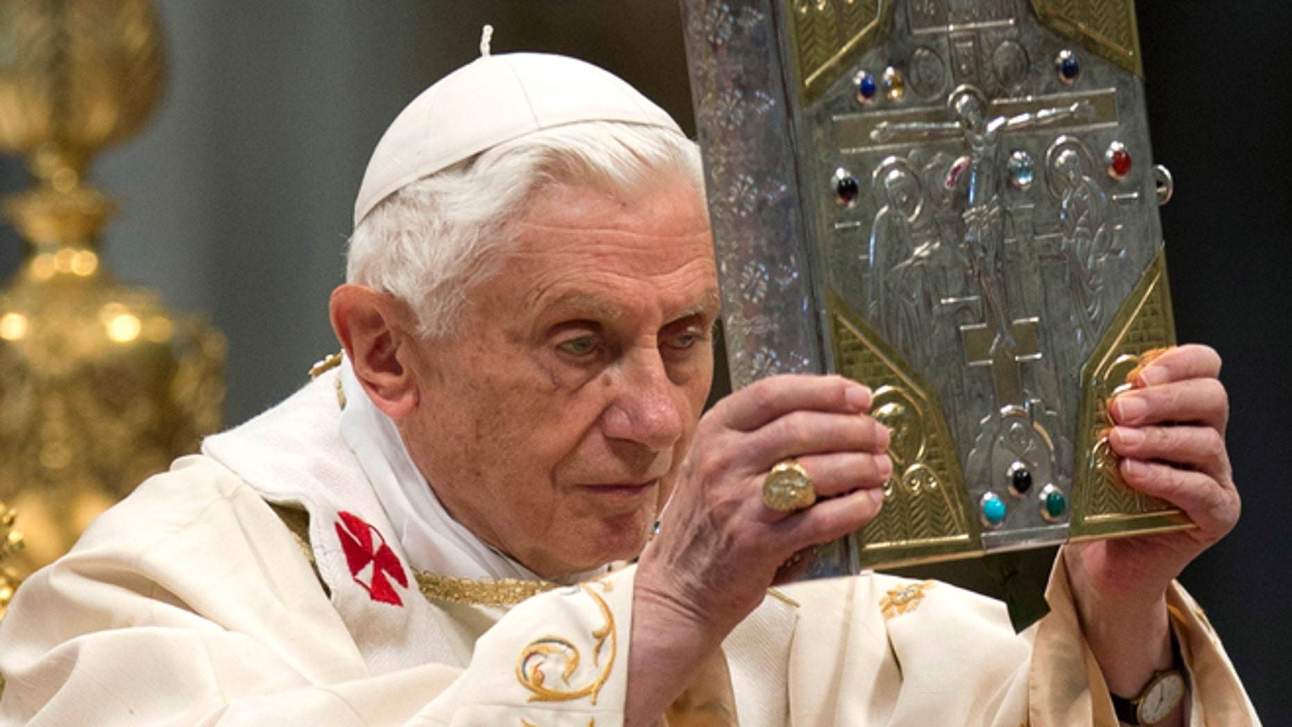 Nov. 25, 2012: Pope Benedict XVI holds the holy Gospel as he celebrates a mass for the newly elected cardinals in St. Peter's Basilica at the Vatican. )