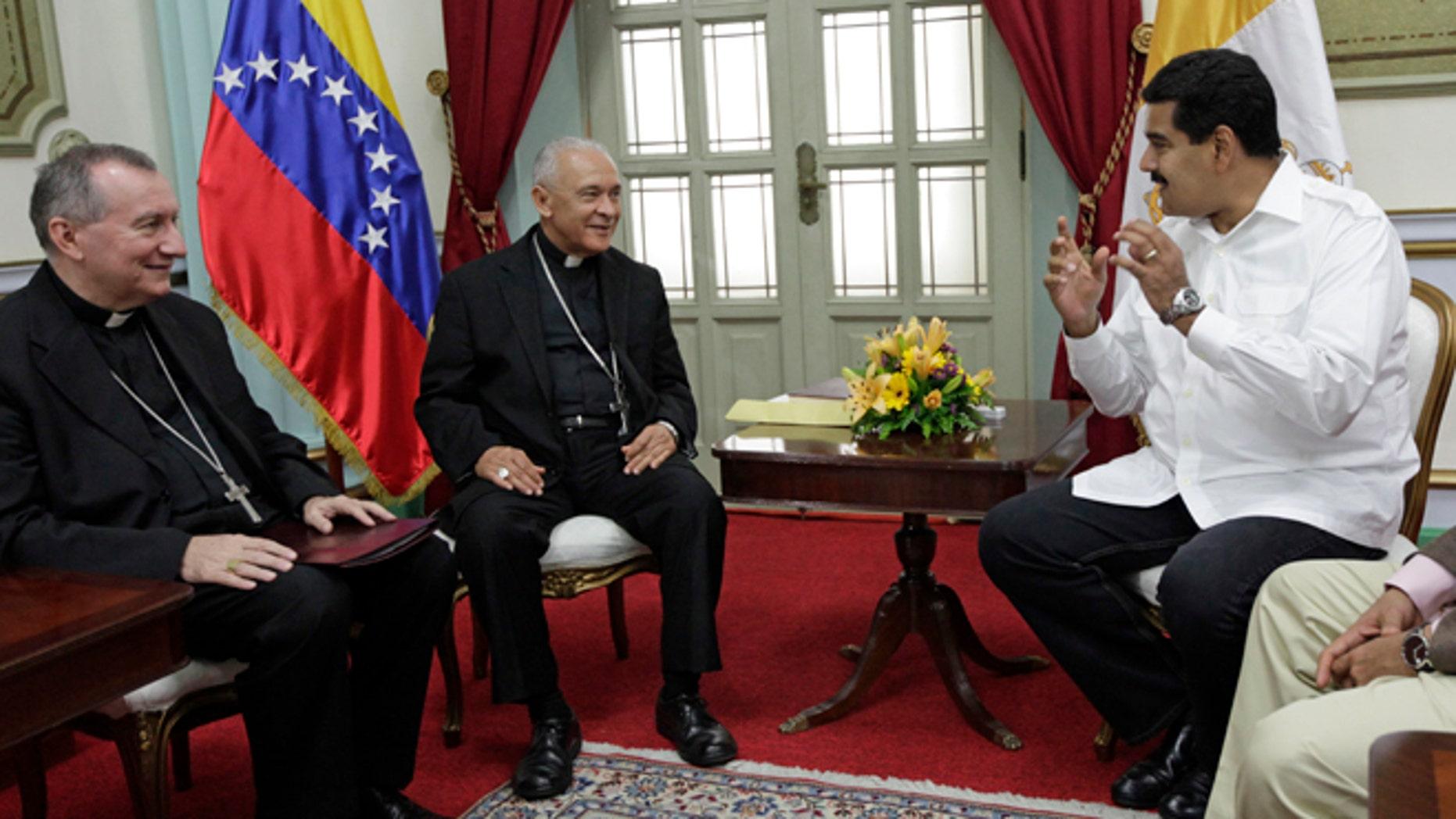 June 14, 2013: In thisphoto, Venezuela's President Nicolas Maduro, right, meets with Venezuela's Archbishop Diego Rafael Padron Sanchez, left and Italian Pietro Parolin, Holy See's representative in Venezuela, at Miraflores presidential palace in Caracas, Venezuela.