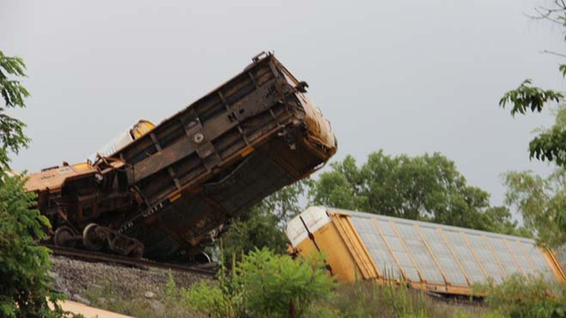 July 14, 2014: This photo provided by the Wythe County public information officer, Jeremy T.K. Farley, shows the scene after 14 railroad cars derailed in Wytheville, Va. (AP/Wythe County, Jeremy T.K. Farley)