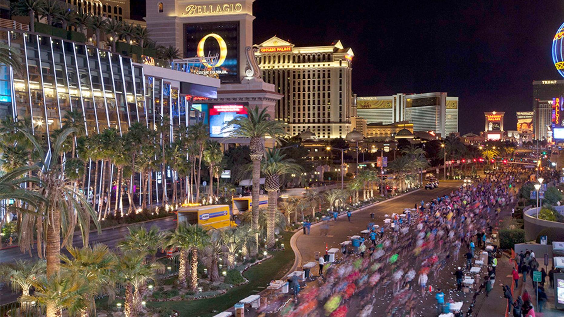 In this Dec. 4, 2011 file photo, runners stream southward on Las Vegas Boulevard during the Rock 'n Roll Las Vegas Marathon in Las Vegas.