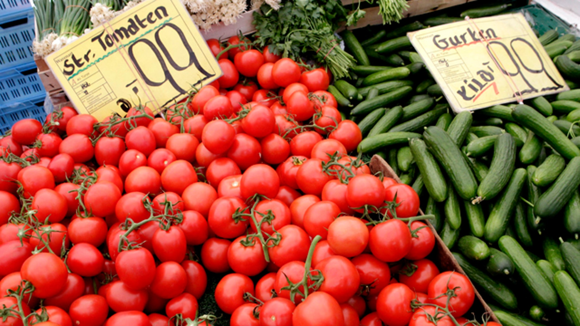 June 3: Tomatoes and cucumbers from Holland are displayed for sale at a market in Berlin, Germany. Nearly 200 new cases of E. coli infection were reported in Germany in the first two days of June, the national disease control center reported Friday, but officials say there are signs the European bacterial outbreak that has killed 18 people could be slowing.