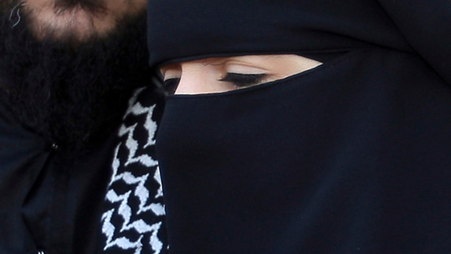 April 23, 2010: Lies Hebbadj, left, and his wife Sandrine Mouleres , speak to reporters in Nantes, western France. A French court on Dec. 12 annulled a fine given to a woman driver wearing an Islamic face veil before France's nationwide ban on the garments goes into effect. Traffic police in the western city of Nantes had fined 31-year-old Sandrine Mouleres in April, saying she did not have a clear field of vision. The fine was just $29, but drew widespread attention amid nationwide debate over the place of Islamic veils in today's France. (AP)