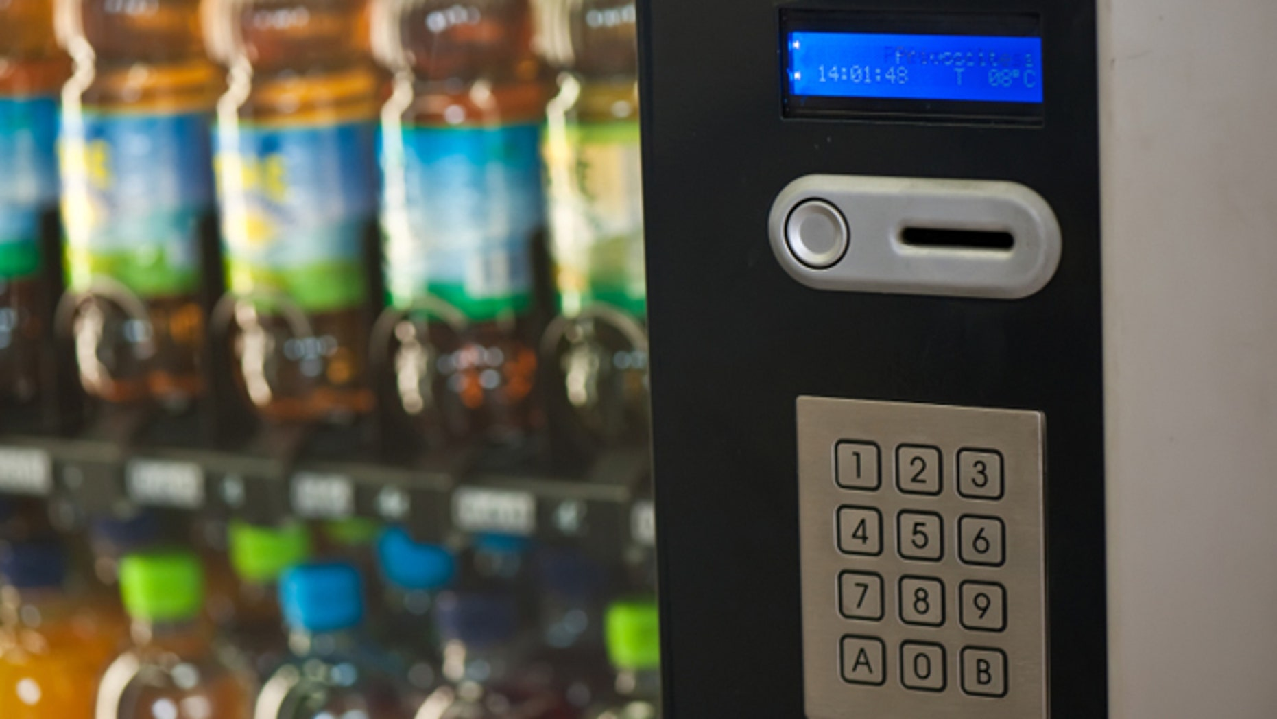 A vending machine provides various beverages