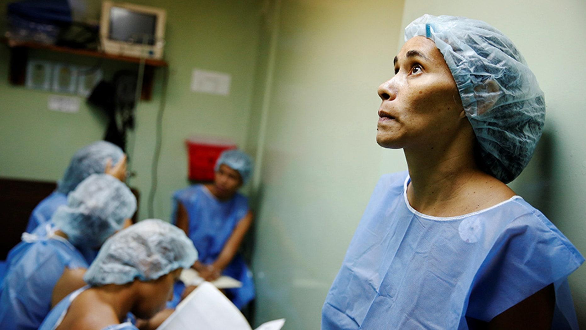 Women wait for sterilization surgery a hospital in Caracas, Venezuela July 27, 2016.