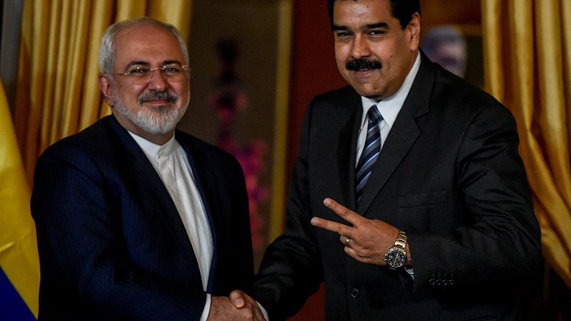 Venezuela's President Nicolas Maduro and Iranian Foreign Minister Mohammad Javad Zarif in Caracas on August 27, 2016.