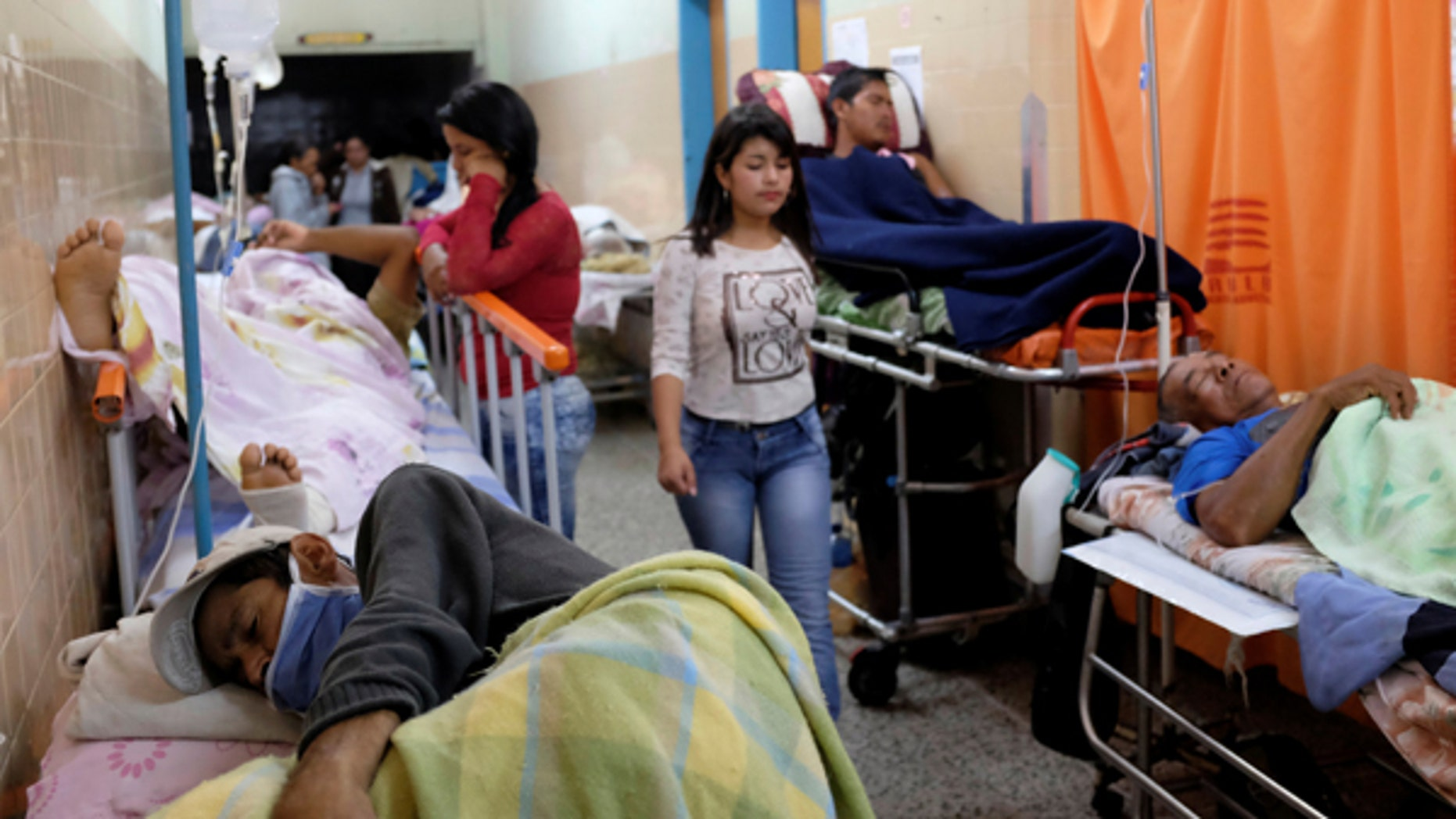 Patients lie on beds in an aisle of the emergency room at the University Hospital in Merida, Venezuela June 17, 2016. Picture taken June 17, 2016.