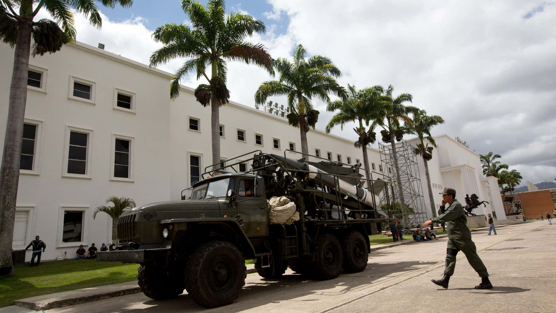 March 14, 2015: A Venezuelan army soldier walks next to a missile system launcher prior starting a civilian and military exercises at fort Tiuna in Caracas, Venezuela.