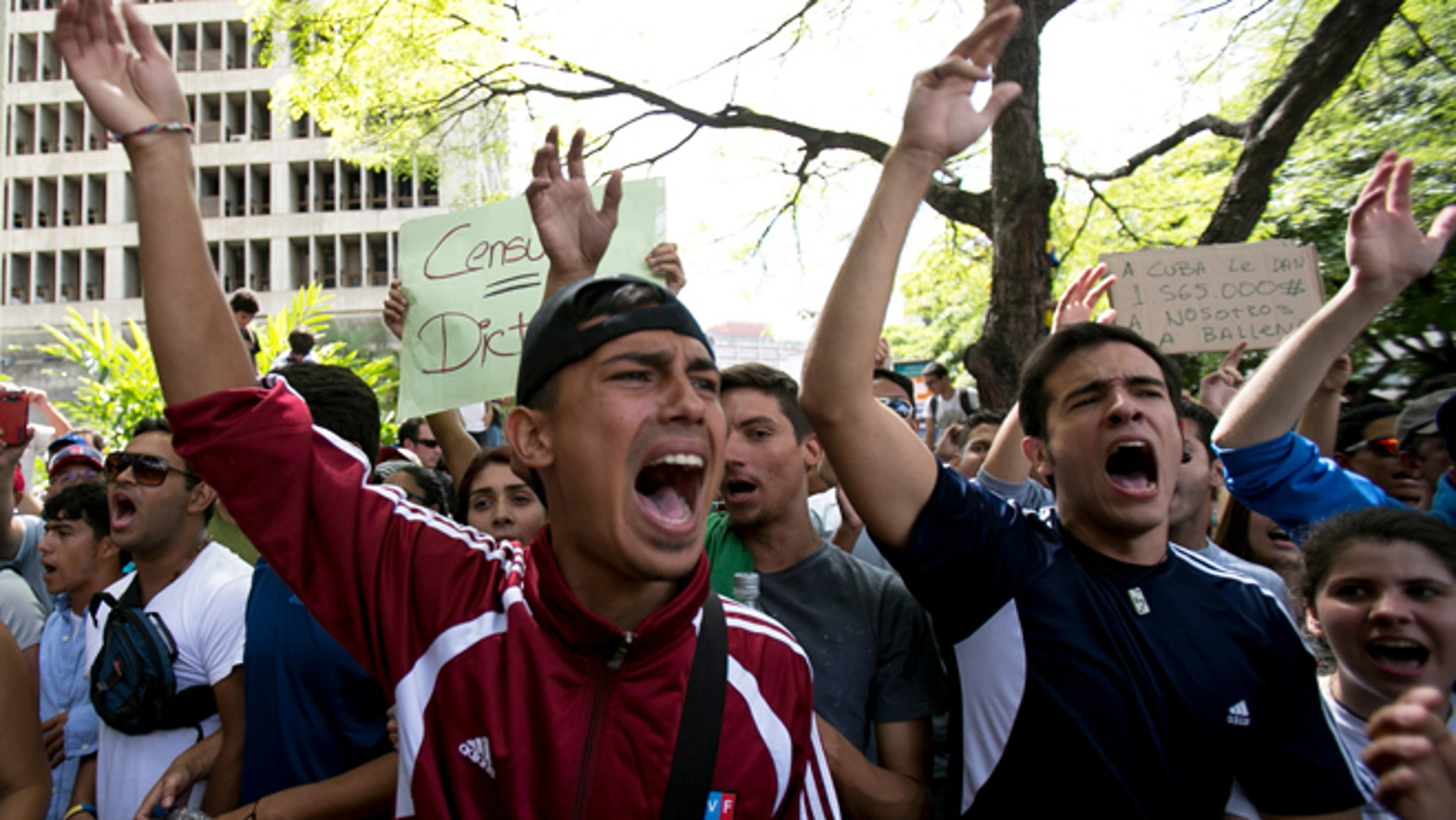Feb. 17, 2014: Students shout slogans against Venezuela's President Nicolas Maduro during a march to Venezuelan Telecommunications Regulator Office or CONATEL in Caracas, Venezuela.