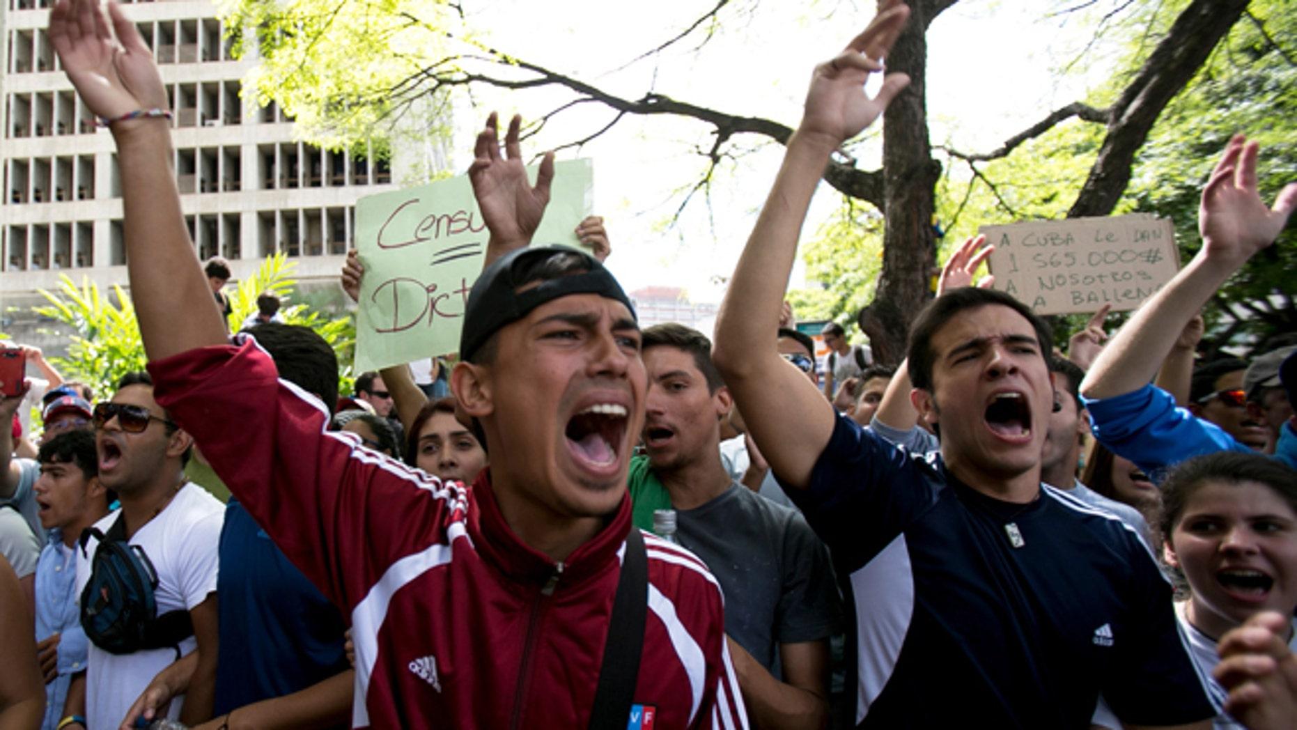 Feb. 17, 2014: Students shout slogans against Venezuela's President Nicolas Maduro during a march to Venezuelan Telecommunications Regulator Office or CONATEL in Caracas, Venezuela.