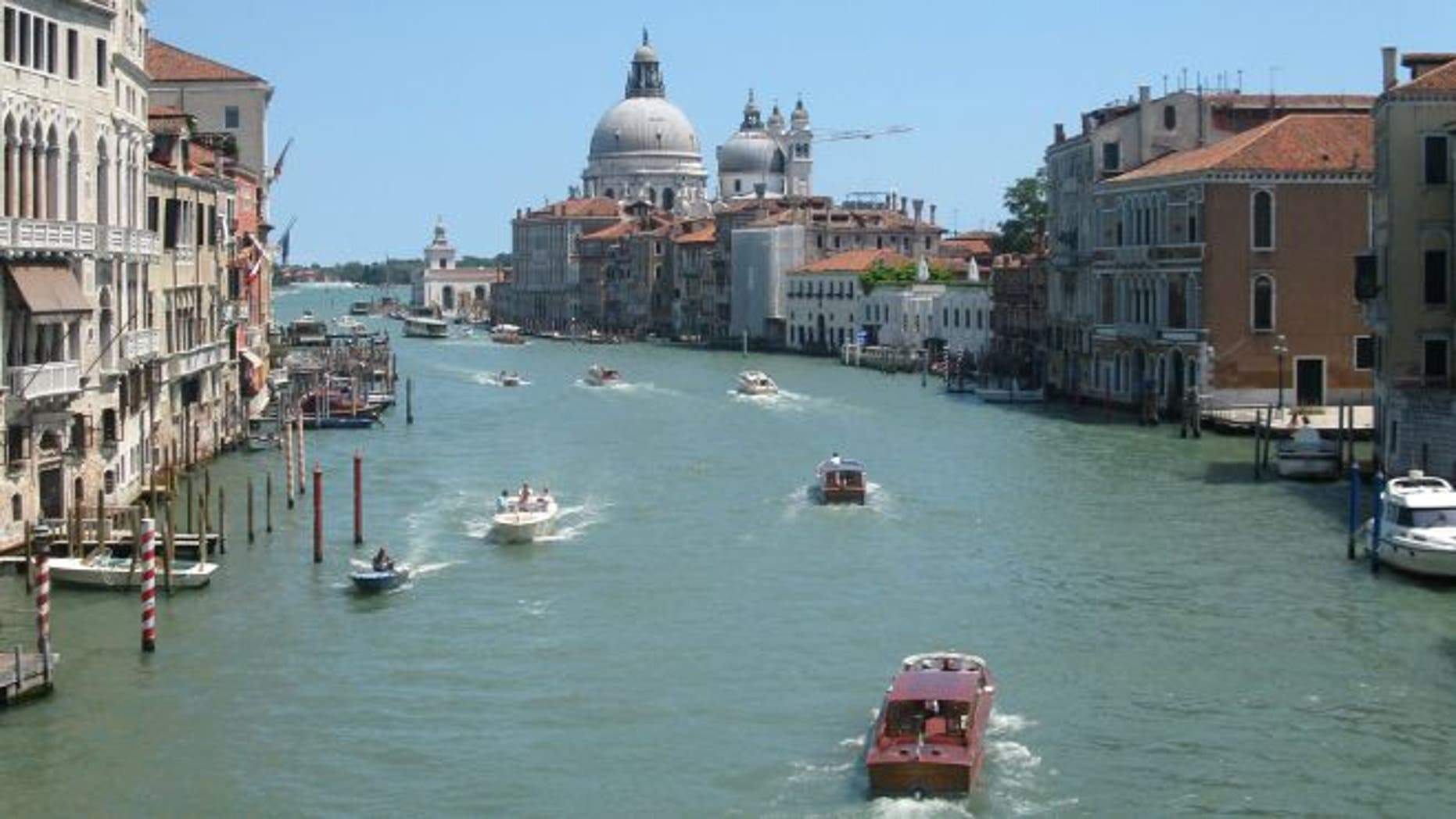 July 17, 2012: Water traffic bustling on the Grande Canale in the heart of Venice, Italy.