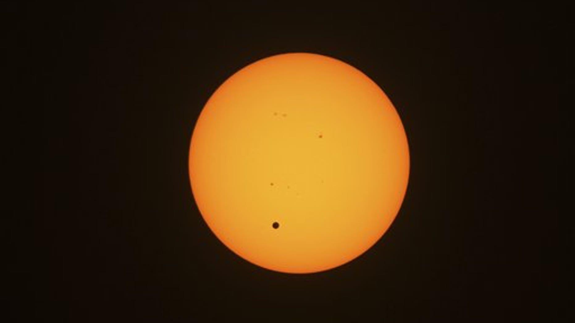 June 6, 2012: This photo taken through viewing glasses shows Venus crossing the sun in Sydney, Australia.