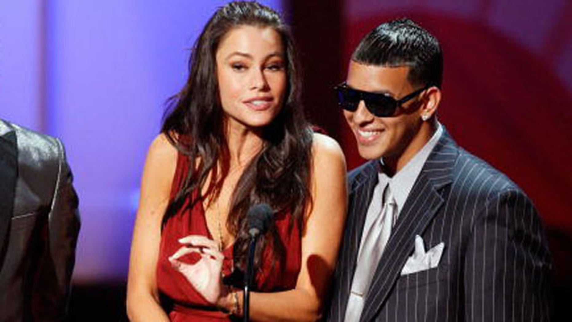 PASADENA, CA - AUGUST 17:  (L-R) Rapper Taboo, actress Sofia Vergara, and rapper Daddy Yankee present the Cheetah Girls performance onstage during the 2008 ALMA Awards at the Pasadena Civic Auditorium on August 17, 2008 in Pasadena, California.  (Photo by Vince Bucci/Getty Images)