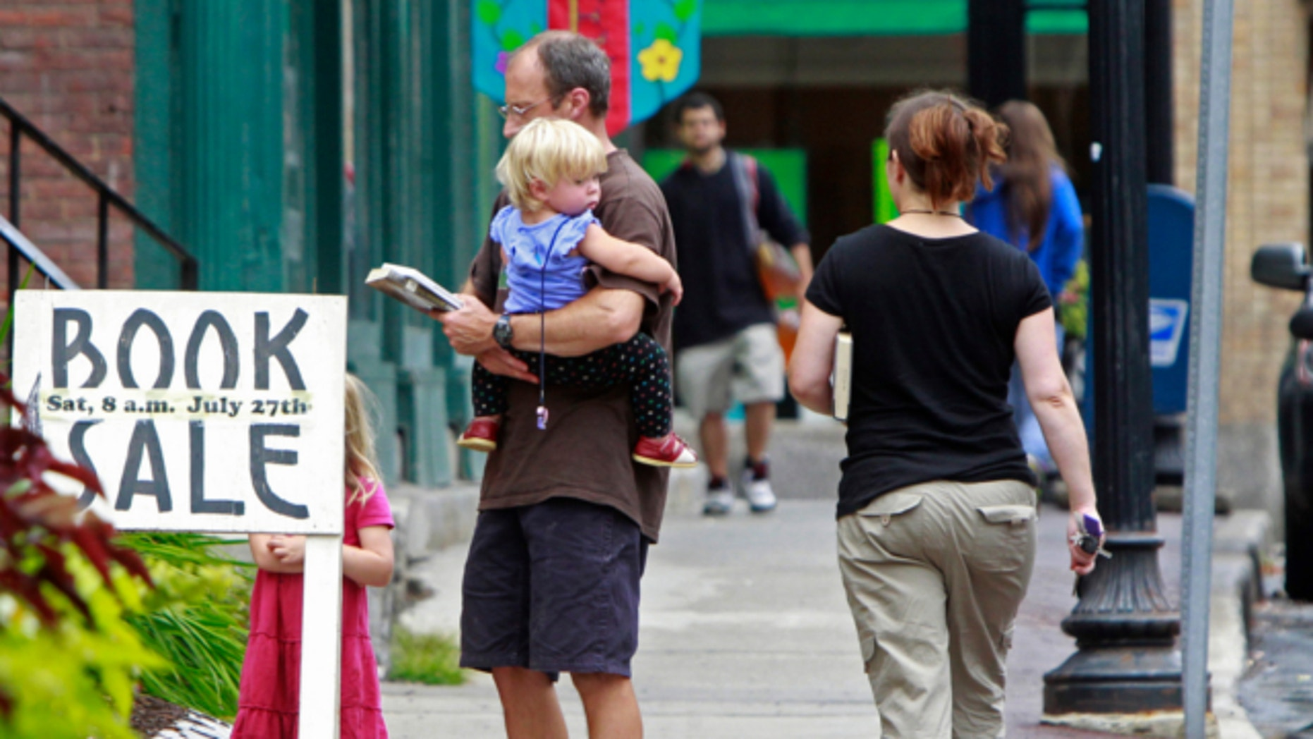 July 23, 2013: People walk down the street in downtown Springfield, Vt. where Timothy J. Szad, a high-risk sex offender, is due to be released on Friday.