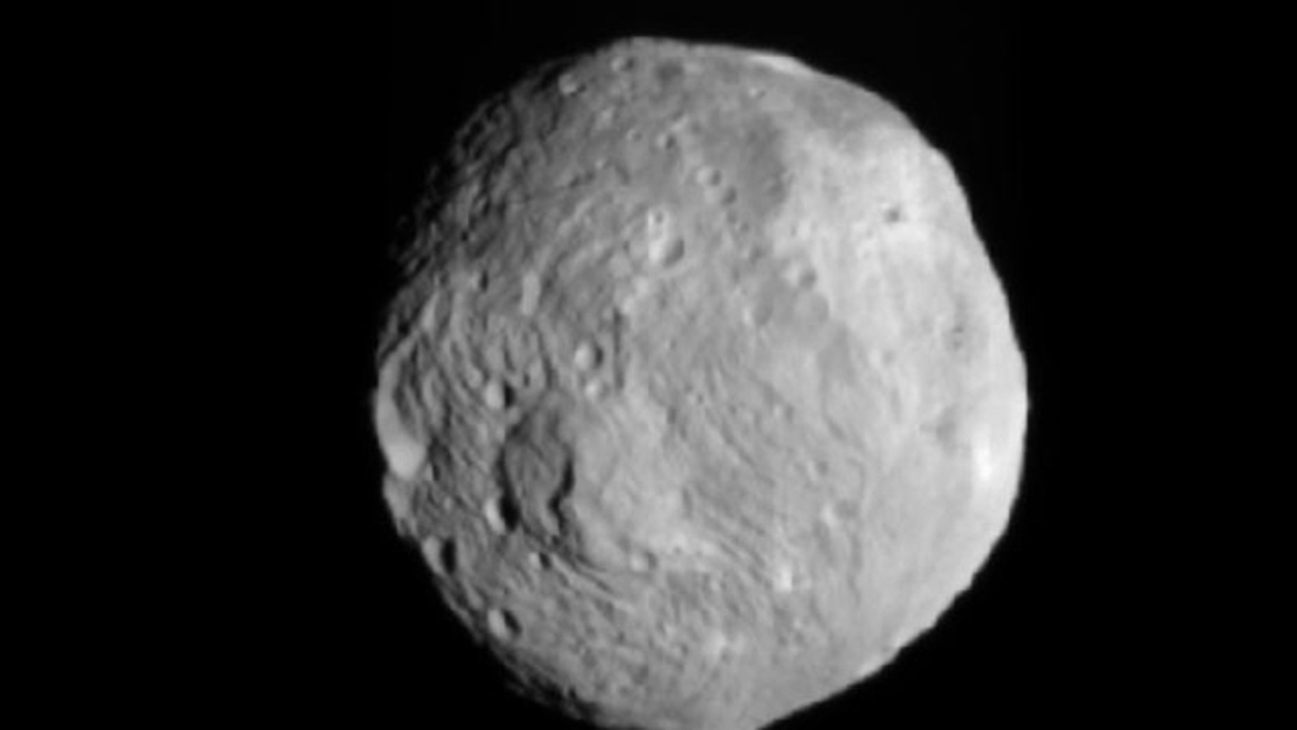 NASA's Dawn spacecraft snapped this photo of the huge asteroid Vesta on July 9, 2011. It was taken from a distance of about 26,000 miles (41,000 kilometers) away from Vesta.