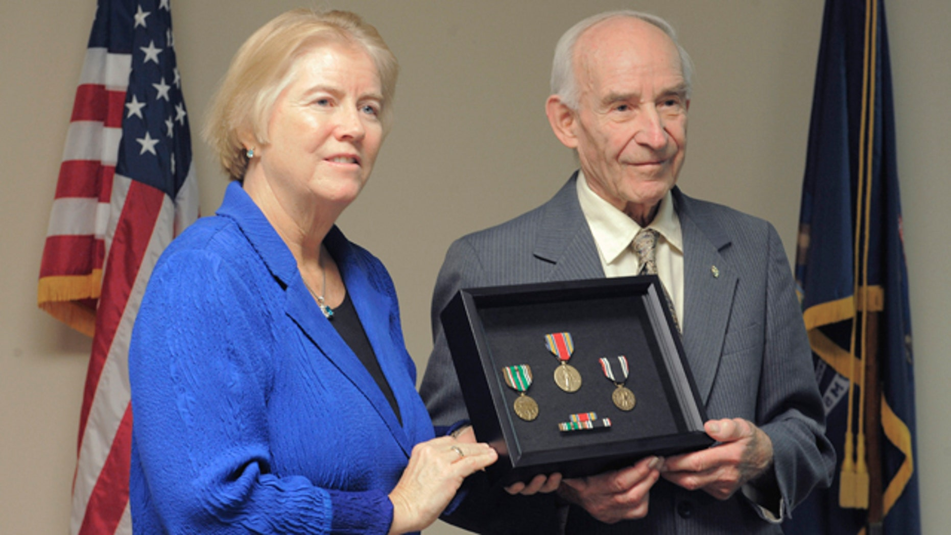 Dec. 7, 2012: Rep. Candice Miller presents William Pollauf with several medals, Friday Dec. 7, 2012, at her office in Shelby Twp., Mich.