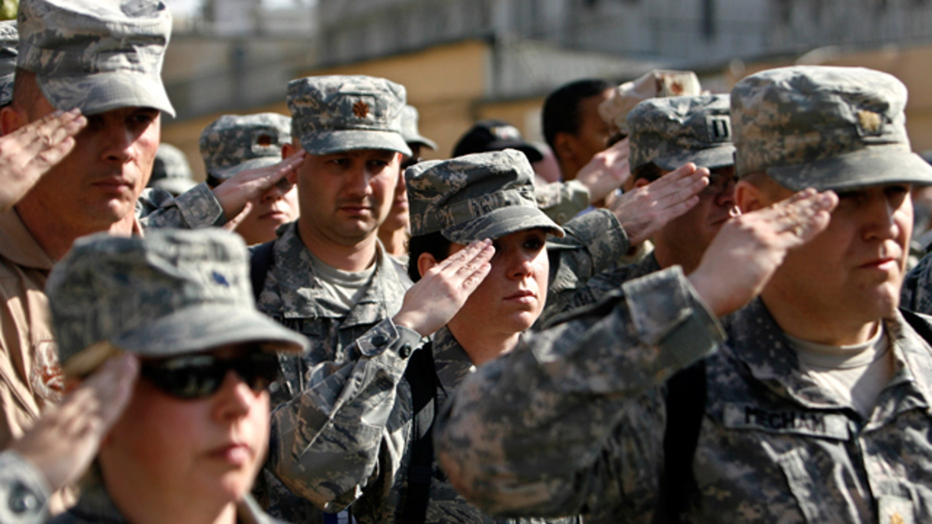 FILE: Nov. 11, 2008: US soldiers of Combined Security Transition Command salute during a Veterans Day ceremony in Kabul, Afghanistan.