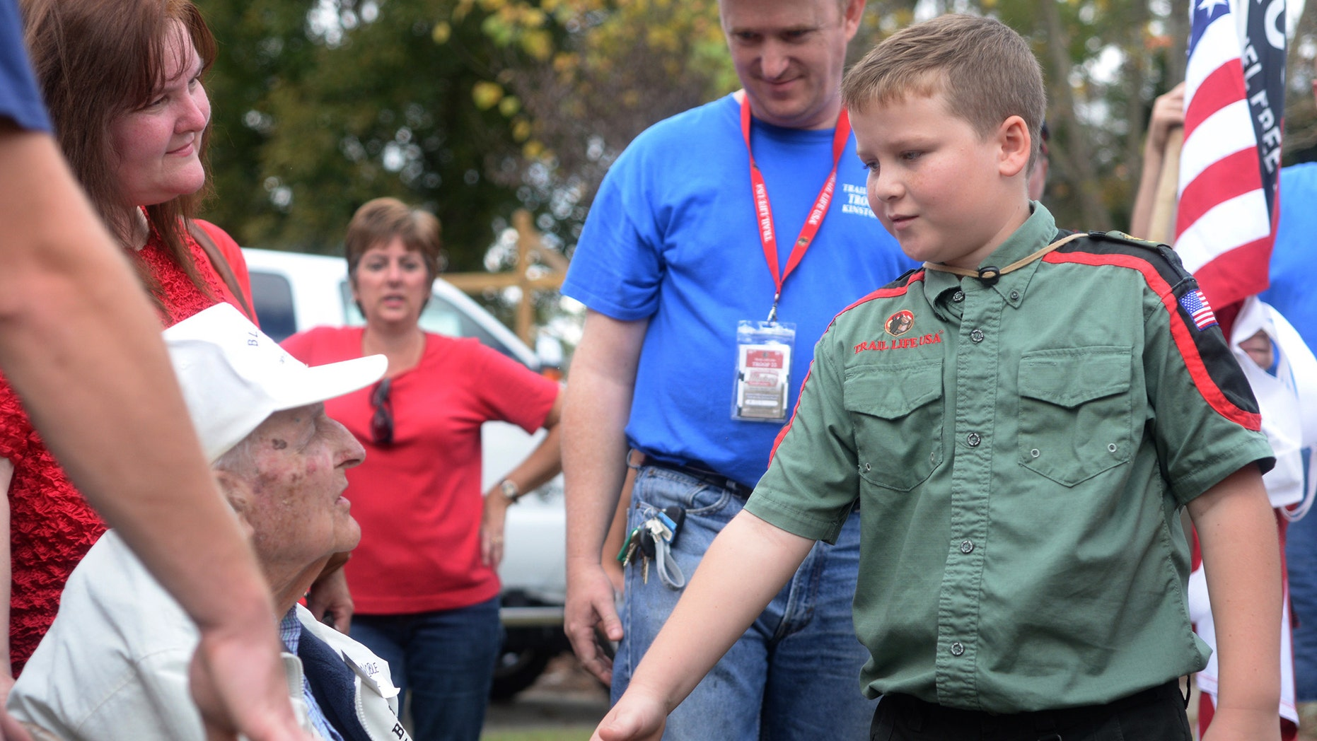 Nov. 7, 2015: Jackson Cannon, 10, of Trail Life USA-Troop 33, shakes hands with World War II veteran Ernest Noble, 95, during a Veteran's Day ceremony at Pearson Park in Kinston, N.C. Noble fought in Belgium, Luxemburg, Holland and Germany. In March of 1945 he helped liberate concentration camps. (Zach Frailey/Daily Free Press via AP)