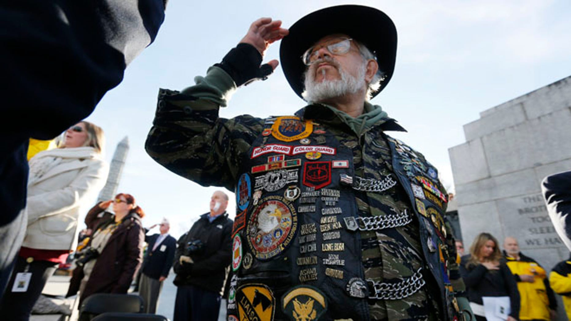 Vietnam veteran Paul Troop, honors his fallen comrades while at the World War II Memorial on Veterans Day in Washington, Nov. 11, 2013.