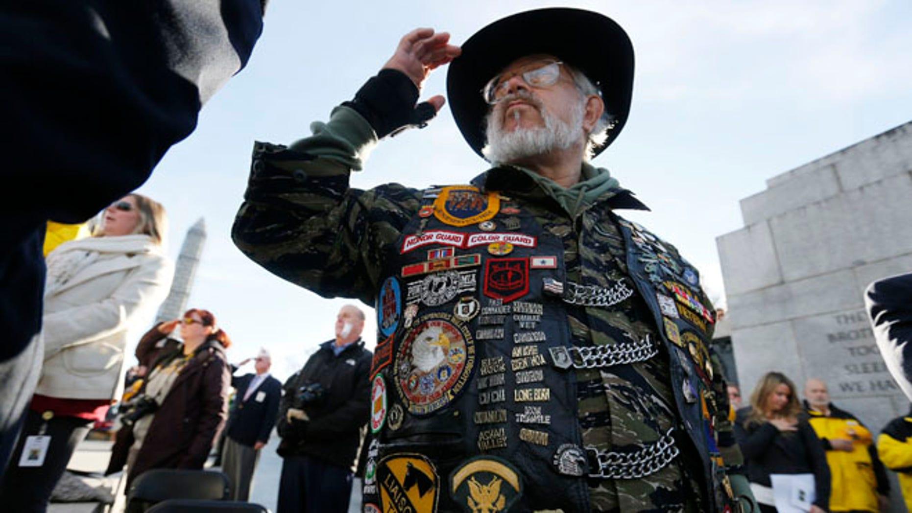 Vietnam veteran Paul Troop, honors his fallen comrades while at the World War II Memorial on Veterans Day in Washington, Nov. 11, 2013.