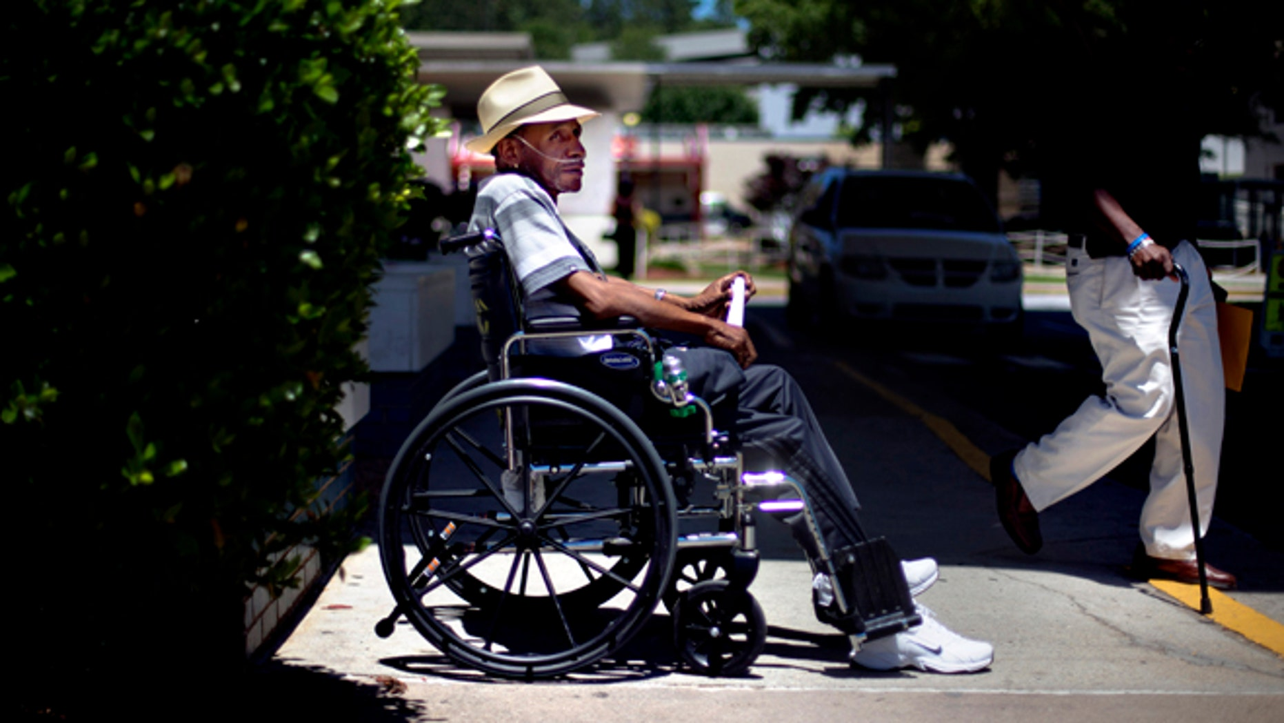 May 24, 2013, Veteran Roy Wiltz, 66, waits to be picked up outside the Atlanta VA Medical Center after a medical appointment, in Atlanta, Ga.