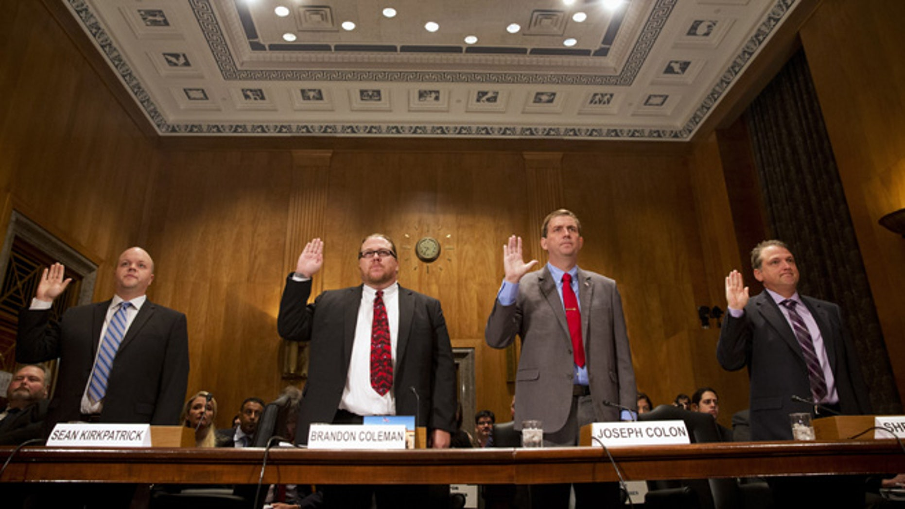 "Sept. 22, 2015: From left, Sean Kirkpatrick of Chicago; Phoenix VA Health Care System Addiction Therapist Dr Brandon Coleman; VA Caribbean Healthcare System Credentialing Program Support Joseph Colon, and Overton Brooks VA Medical Center Licensed Clinical Social Worker Shea Wilkes are sworn on Capitol Hill in Washington, prior to testifying before the Senate Homeland Security and Governmental Affairs Committee hearing on ""Improving VA Accountability: Examining First-Hand Accounts of Department of Veterans Affairs Whistleblowers.""  (AP)"