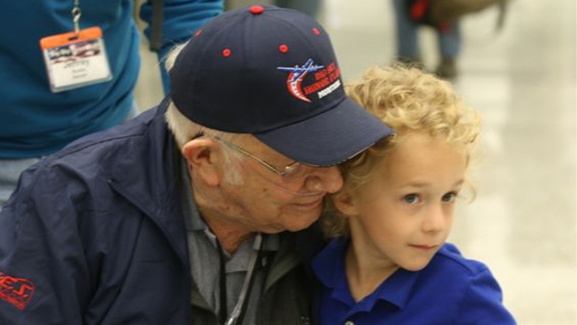 April 27, 2014: Eli Wilke, 6, gives Montana World War II veteran Donald Buska, left, a hug as he arrives at Dulles International airport in Dulles, Va. Buska fulfilled his longtime dream of traveling to Washington and visiting the National World War II Memorial with the help of Big Sky Honor Flight of Montana.