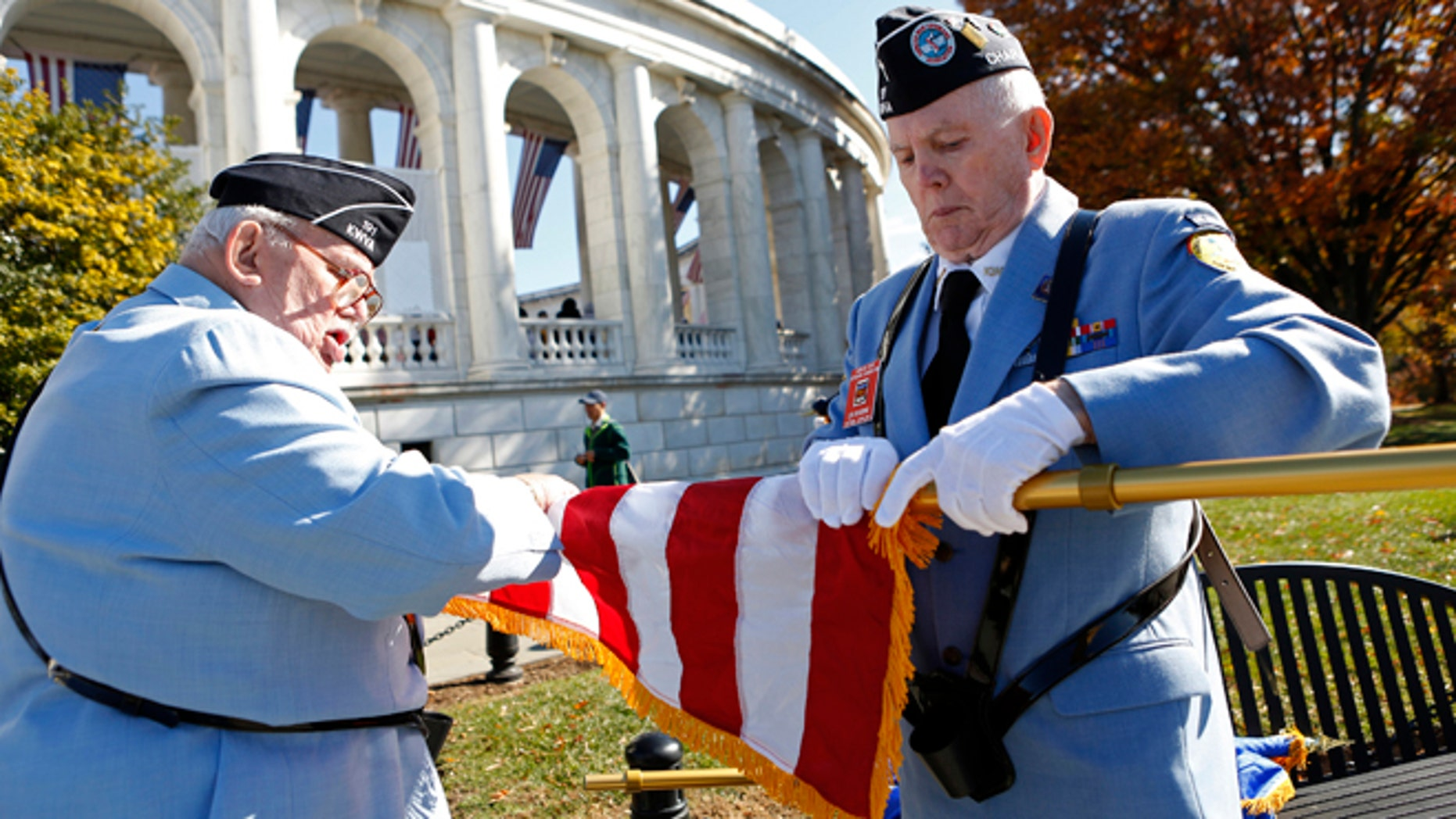 Nov. 11, 2013: Members of a veterans' honor guard furl a flag after a ceremony at Arlington National Cemetery on Veterans Day in Washington.