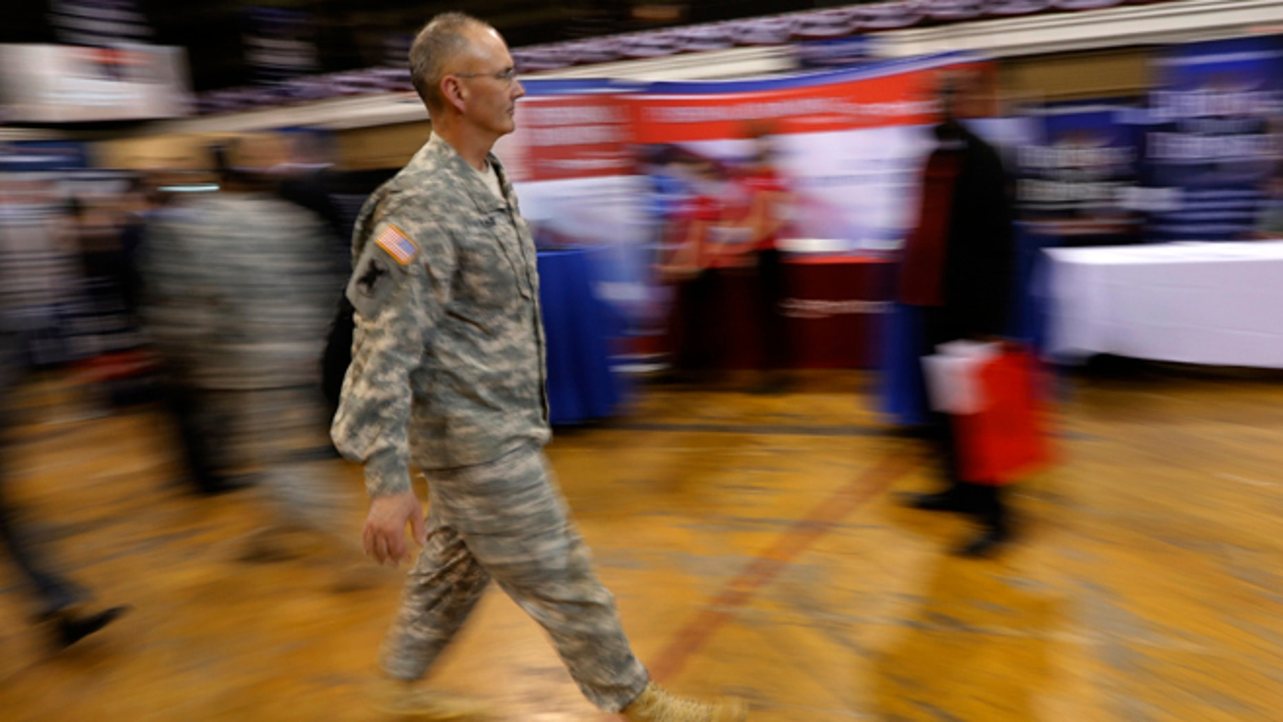 FILE: March 27, 2013: A military officer attends a job fair in New York.