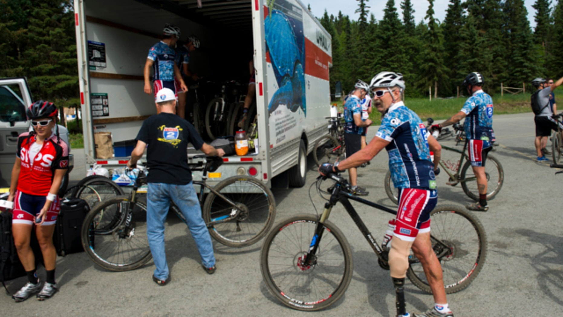 June 25, 2013: Mountain bikers in the Ride 2 Recovery group finish a ride on the Anchorage Hillside.