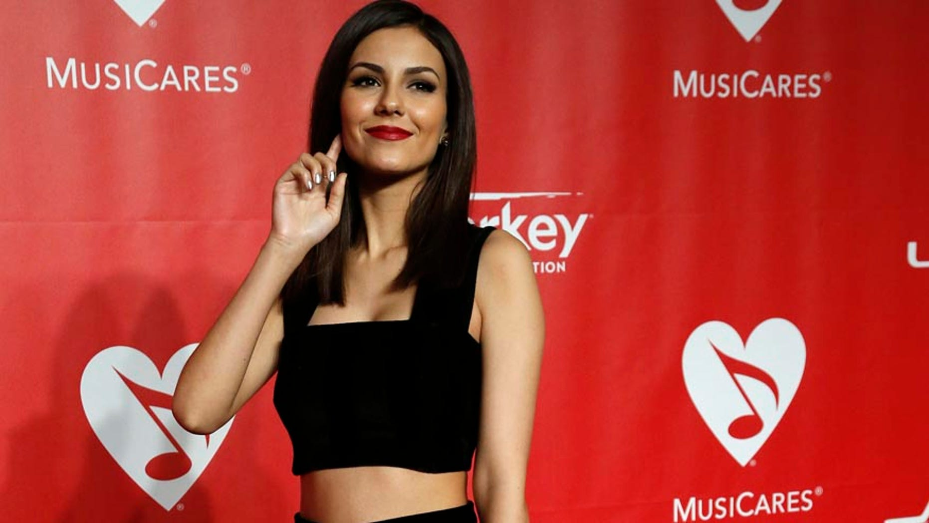 Actress Victoria Justice arrives at the 2015 MusiCares Person of the Year tribute honoring Bob Dylan in Los Angeles, California February 6, 2015.  REUTERS/Mario Anzuoni (UNITED STATES  - Tags: ENTERTAINMENT)   - RTR4OKKY