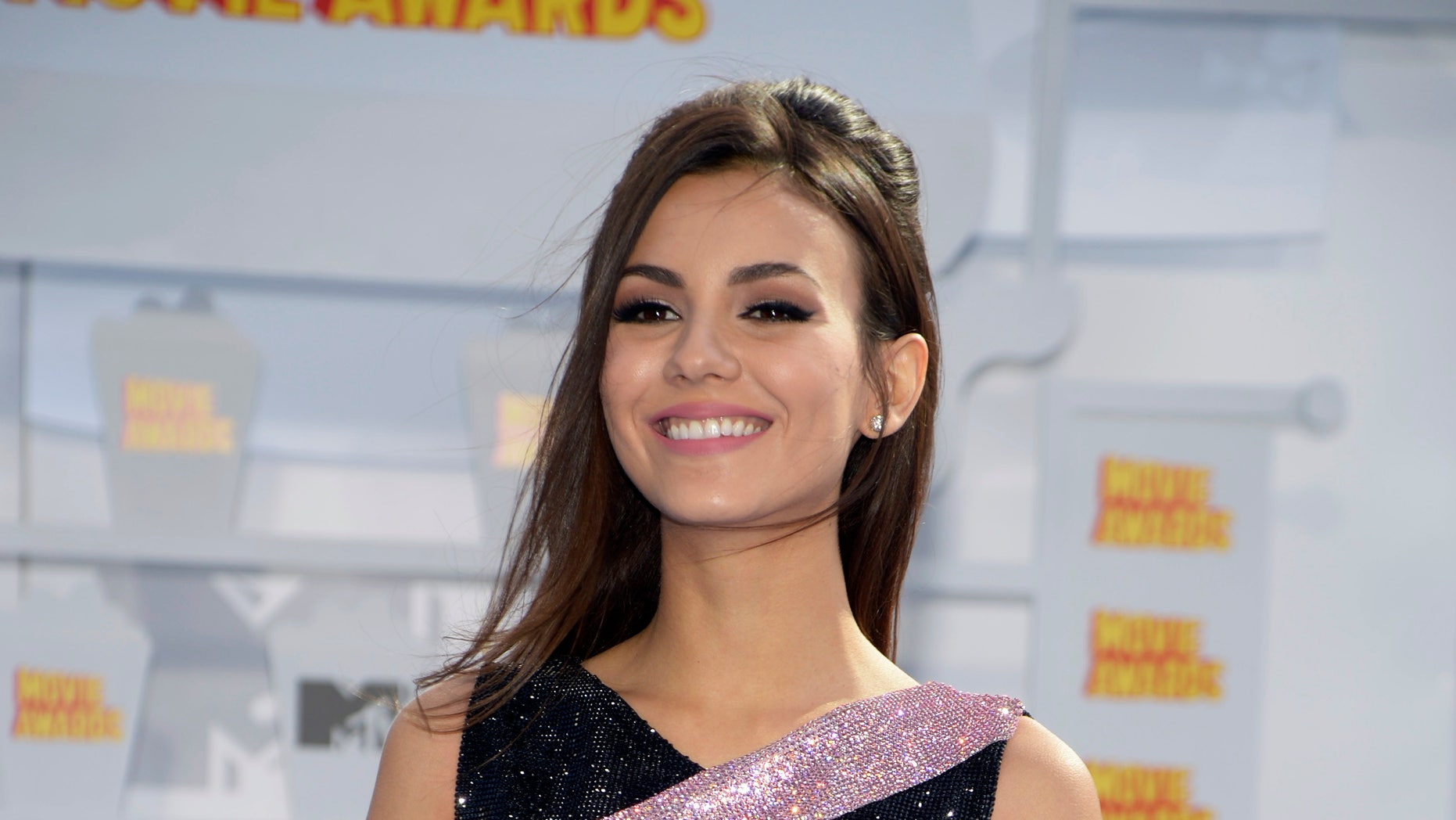 Actress Victoria Justice arrives at the 2015 MTV Movie Awards in Los Angeles, California April 12, 2015. REUTERS/Phil McCarten - RTR4X1OY