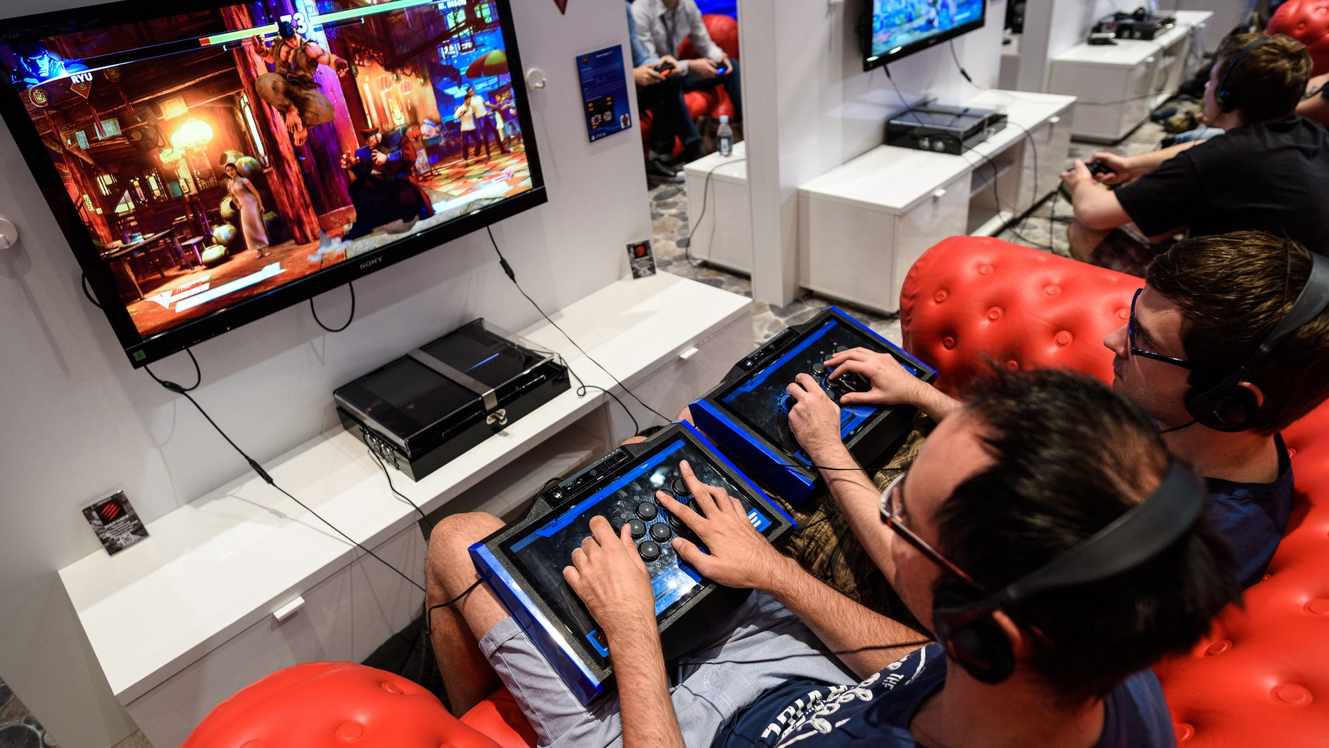 COLOGNE, GERMANY - AUGUST 05:  People play video games at the Sony Playstation stand at the Gamescom 2015 gaming trade fair during the media day on August 5, 2015 in Cologne, Germany. Gamescom is the world's largest digital gaming trade fair and will be open to the public from August 6-9.  (Photo by Sascha Schuermann/Getty Images)