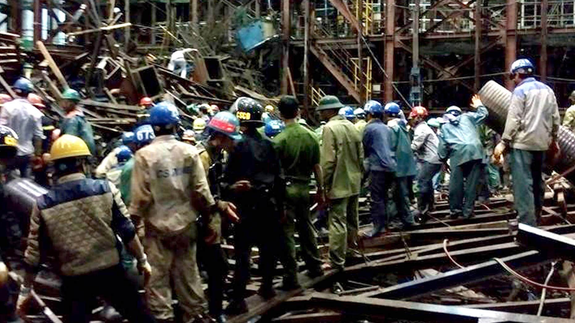 March 25, 2015: Rescuers work through the rubble trying to find survivors after scaffolding collapsed in an economic zone in Ha Tinh province in central Vietnam.