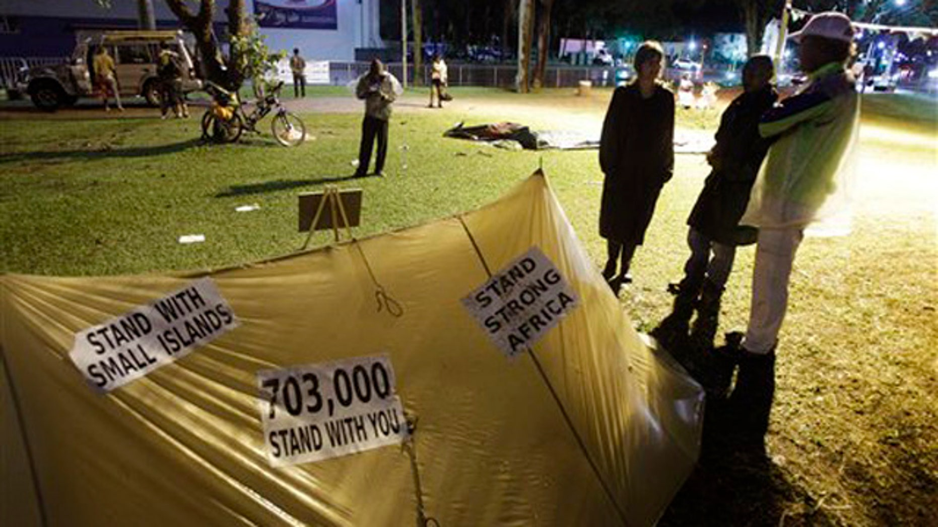 Dec. 9, 2011: Protesters hold a night vigil as talks at the climate change summit stall in Durban, South Africa.